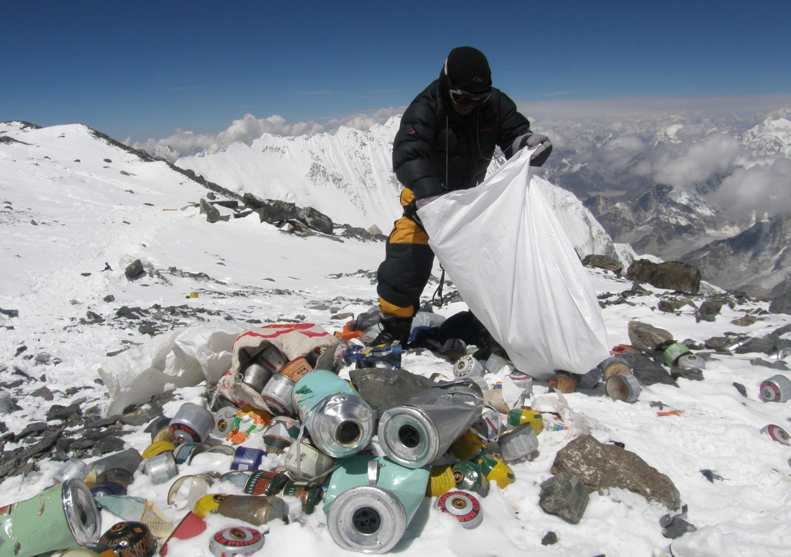This picture taken on May 23, 2010 shows a Nepalese sherpa collecting garbage, left by climbers, at an altitude of 8,000 meters during the Everest clean-up expedition at Mount Everest.