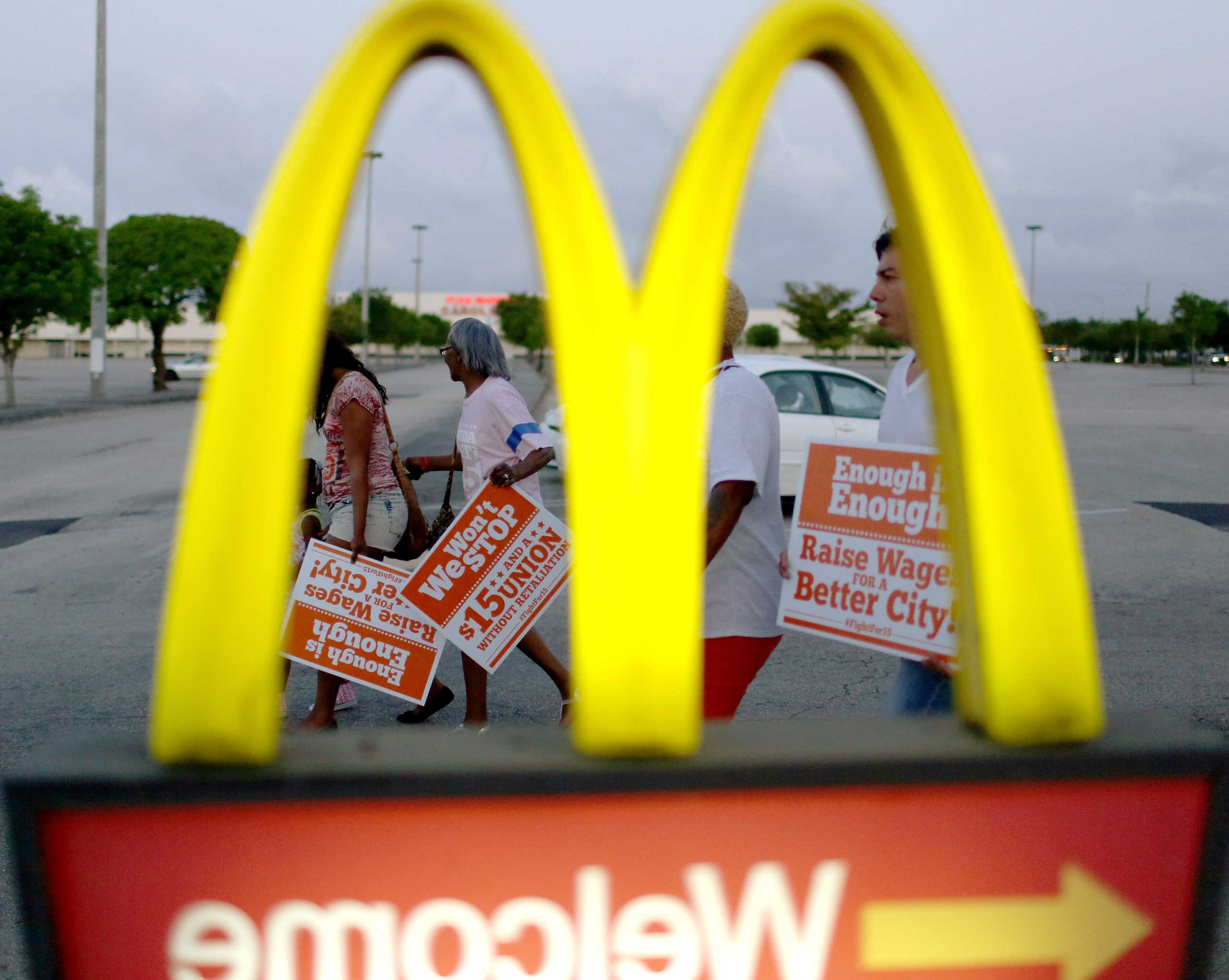 Protesters gather at a McDonald's restaurant on tax day asking for higher wages in Miami Gardens, Fla., on April 15, 2015.
