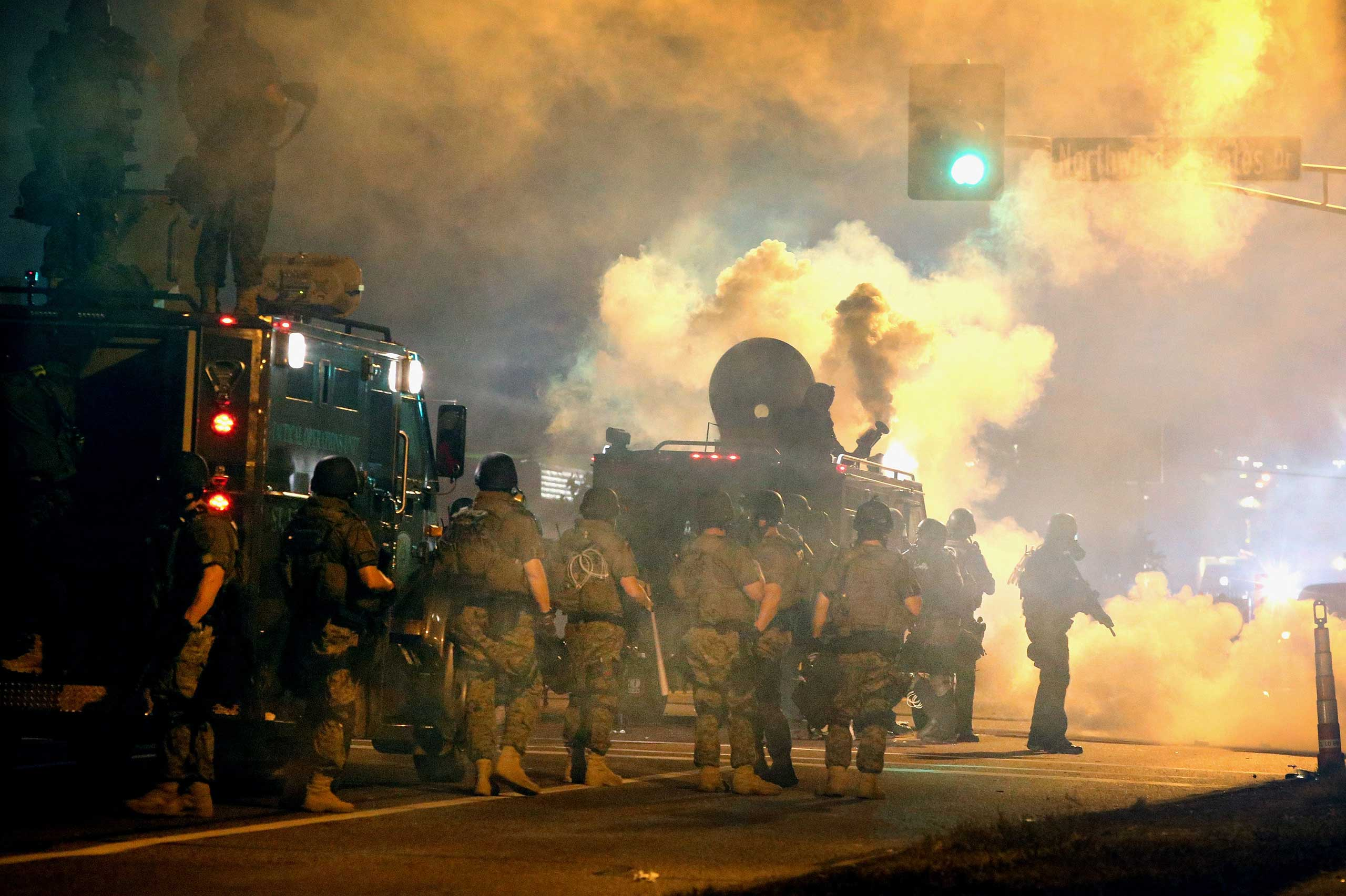 Police and Missouri National Guard attempt to control demonstrators protesting the killing of teenager Michael Brown on Aug. 18, 2014 in Ferguson, Mo.