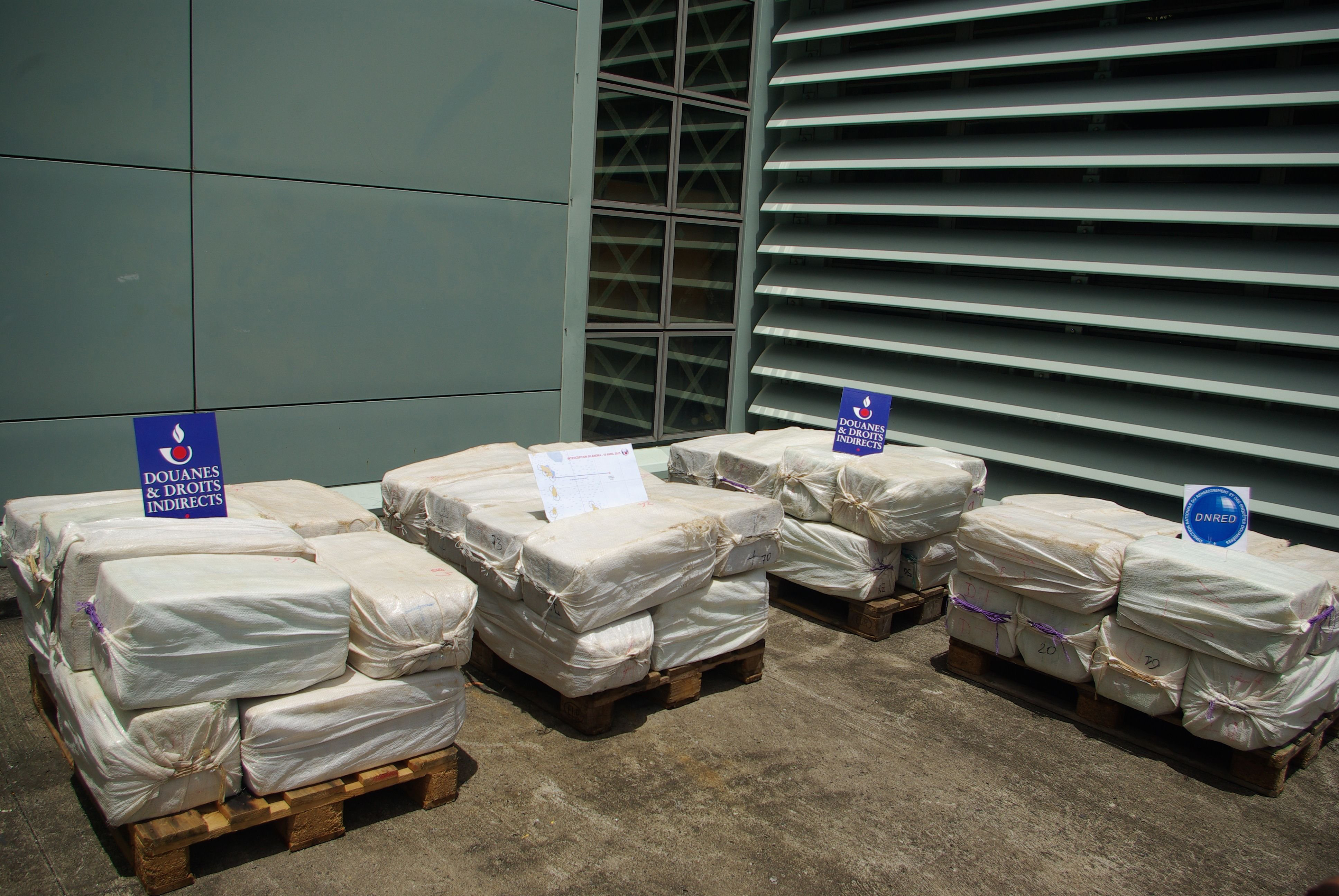 This file photo released on April 18, 2015 by French customs in Fort Saint-Louis military base in Fort-de-France, on the French Caribbean island of Martinique shows packs of cocaine stored after they were seized on April 15, 2015 on a sailboat off the French Caribbean island of Martinique.