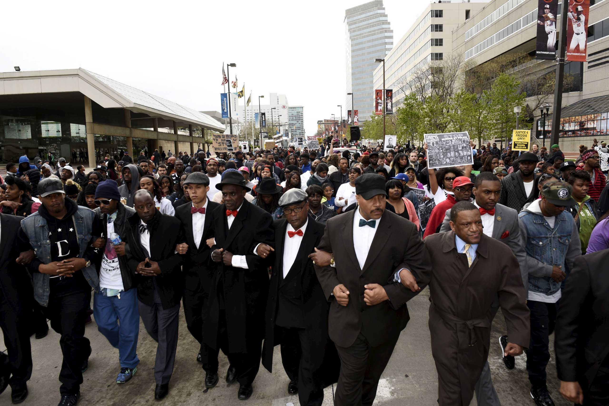 Demonstrators march to City Hall to protest against the death of Freddie Gray in police custody, in Baltimore on April 25, 2015.