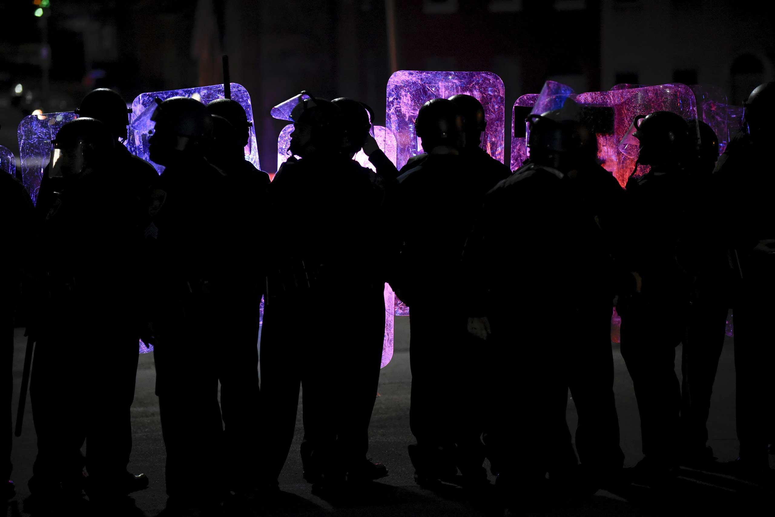 Law enforcement officers stand guard near Baltimore Police Department Western District in Baltimore on April 25, 2015.