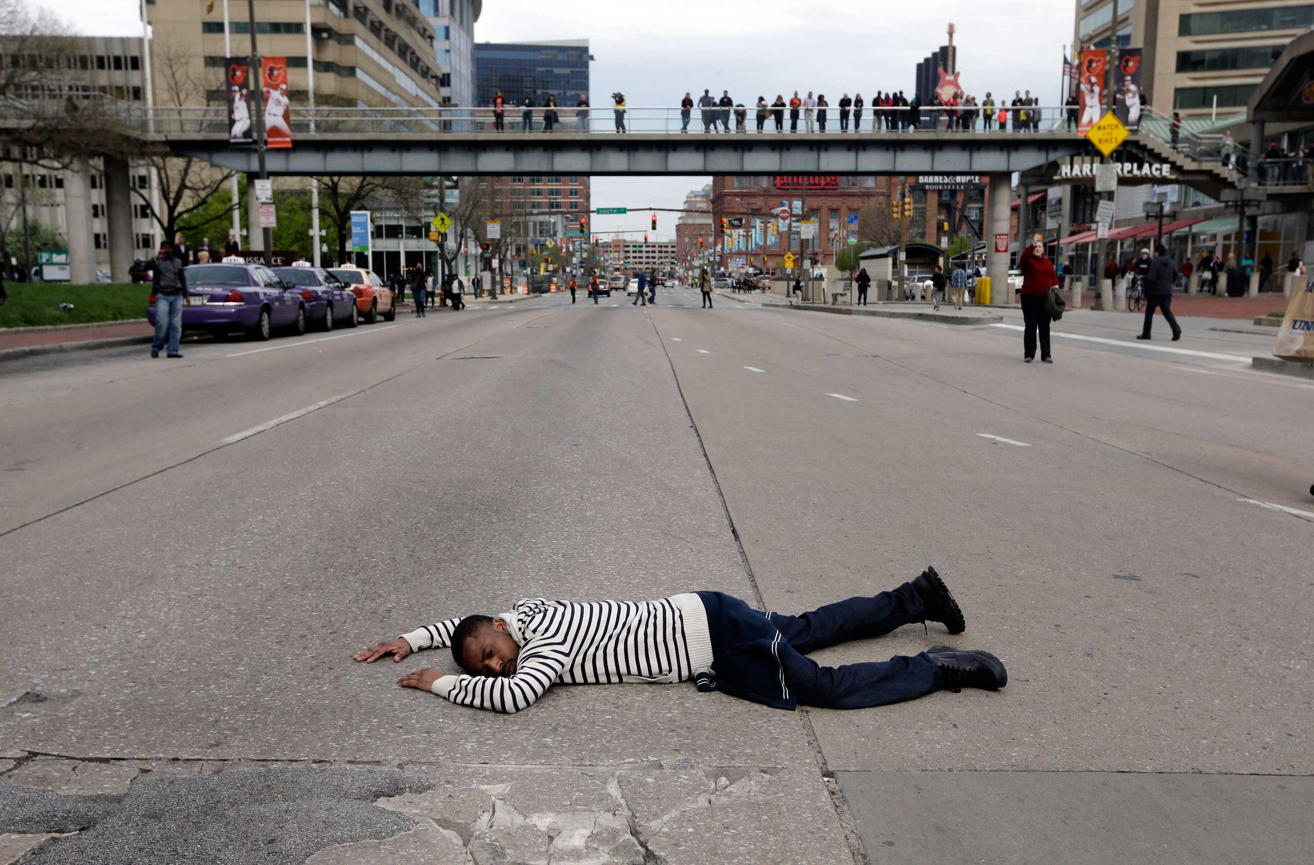 A protestor lays in the middle of a street during a march for Freddie Gray in Baltimore on April 25, 2015.
