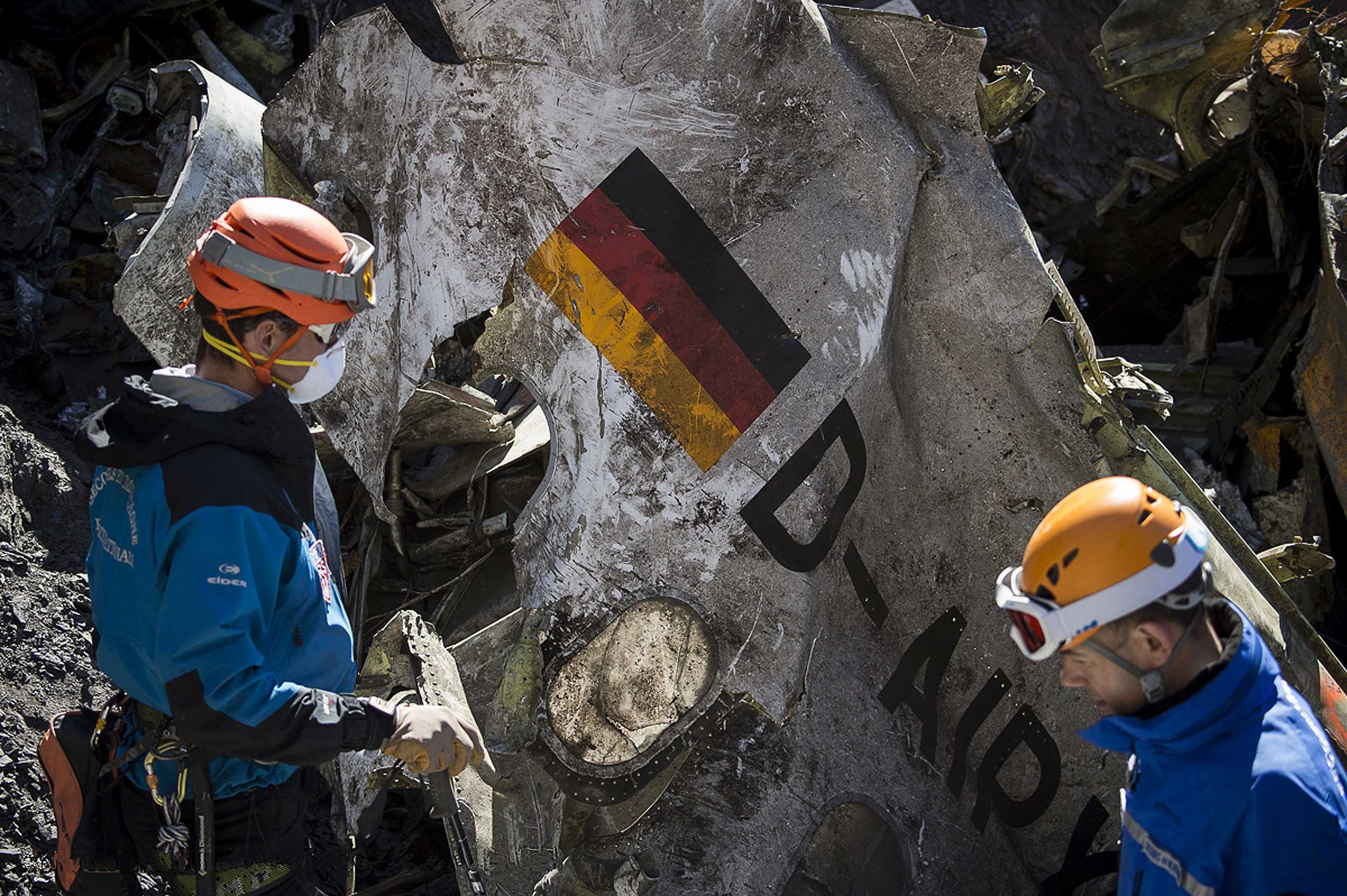Gendarmes and rescuers from the Gendarmerie High-Mountain Rescue Group working at the crash site of the Germanwings Airbus A320 near Le Vernet, French Alps, on March 31, 2015.
