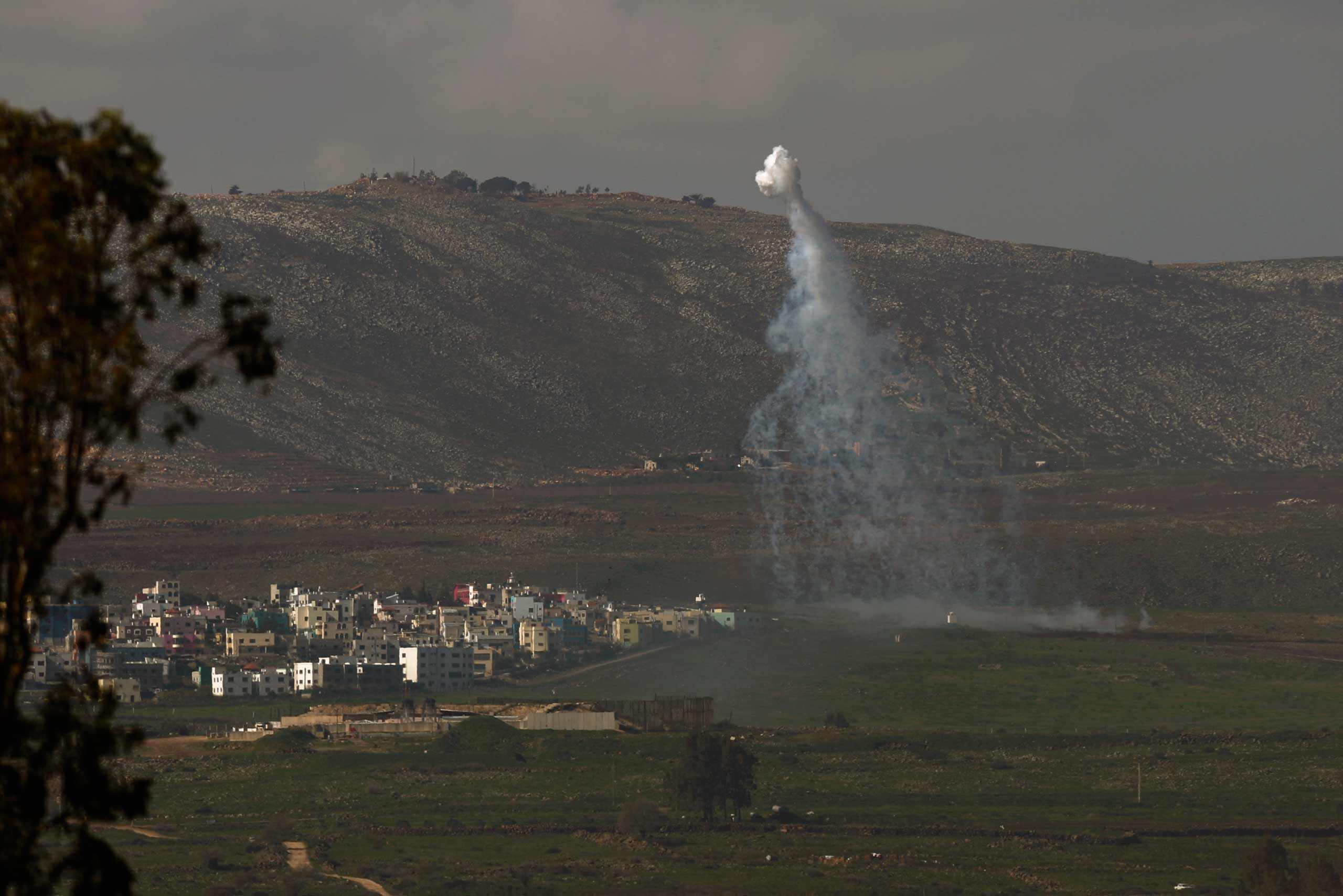 Smoke rises next to the village of Ghajar on the Israeli-Lebanese border, as a result of the fire exchange between the Israeli and Hizballah militant group on Jan. 28, 2015.