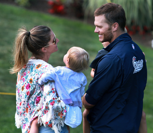 Tom Brady and wife Gisele Bündchen with their two children outside of Gillette Stadium on August 11, 2014.