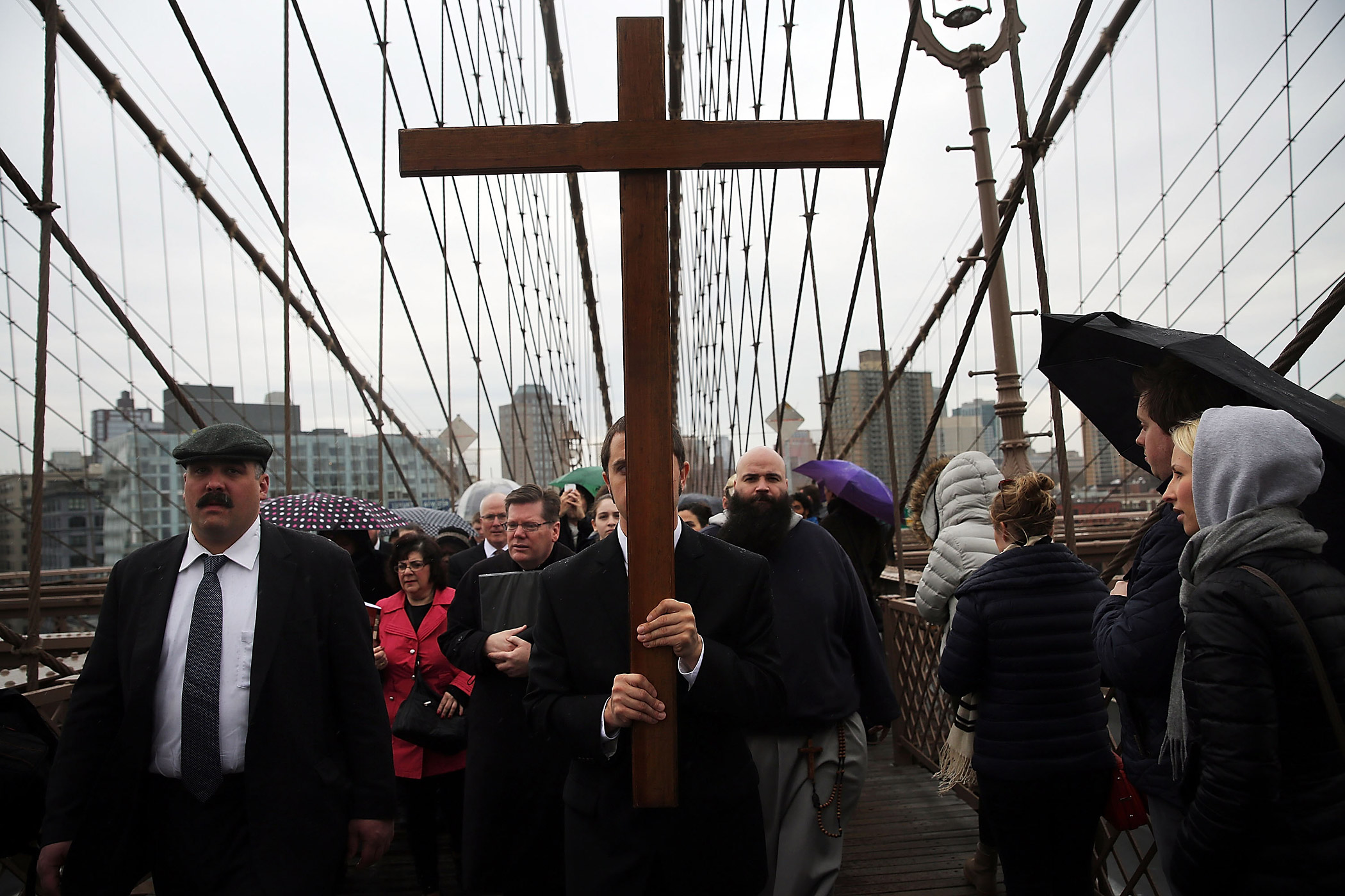 Members of the Archdiocese of New York and the Diocese of Brooklyn lead the Way of the Cross procession over the Brooklyn Bridge on April 3, 2015 in New York City.