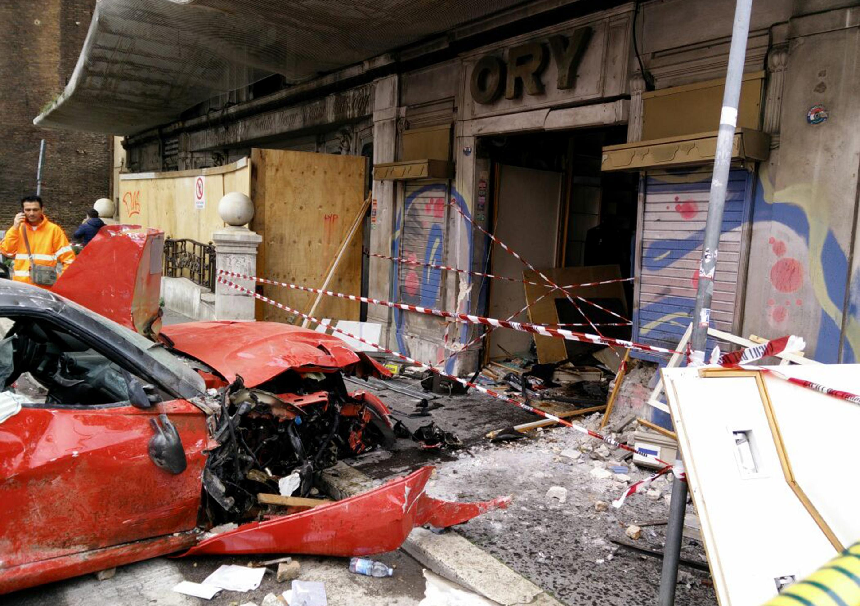 The aftermath following a ferrari 599 GTO which crashed into a shop in Viminale's road in Rome, Italy, on March 30, 2015