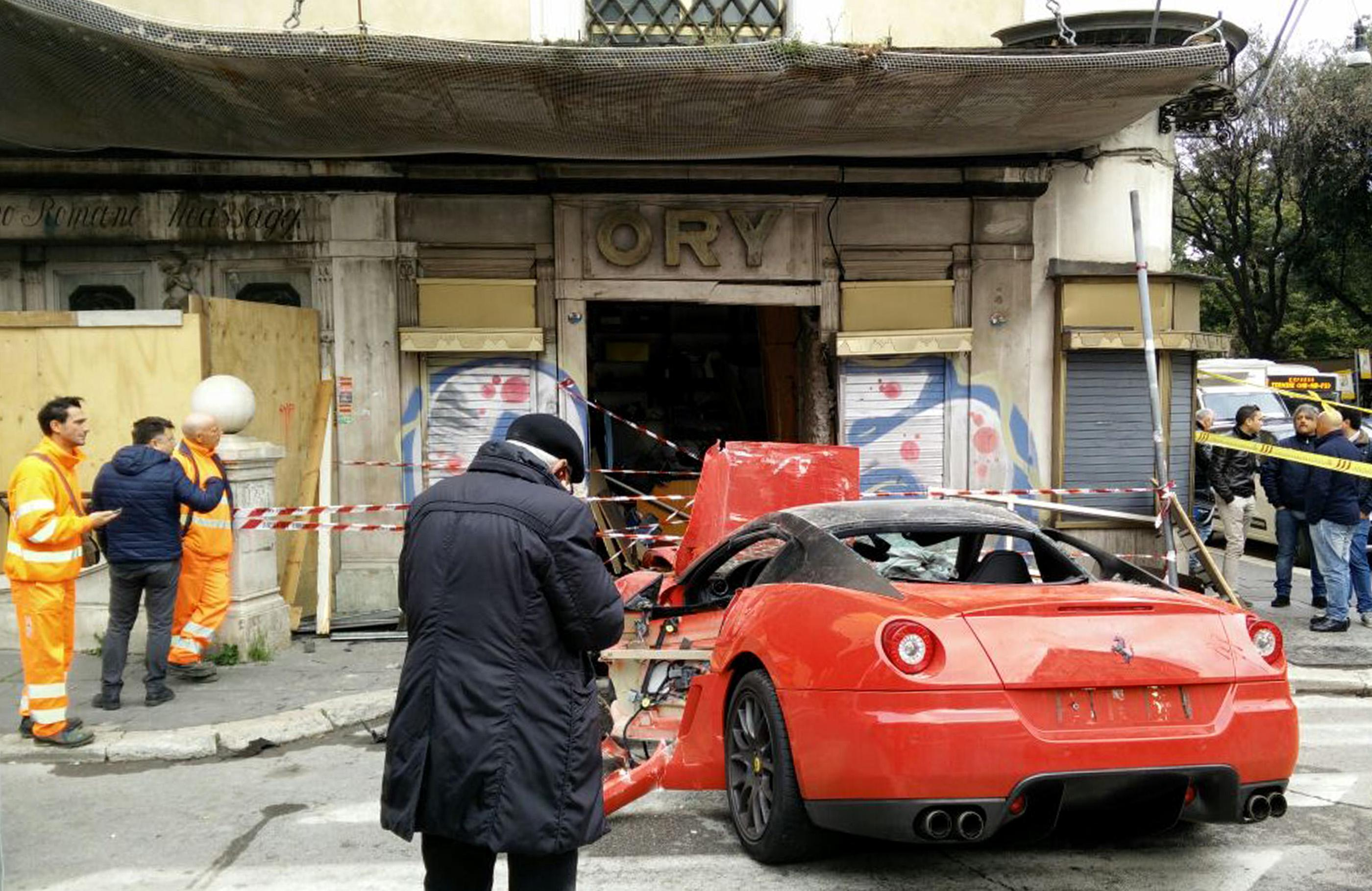 A photograph made available on 01 April 2015 showing the aftermath following a ferrari 599 GTO which crashed into a shop in Viminale's road in Rome, Italy 30 March 2015.