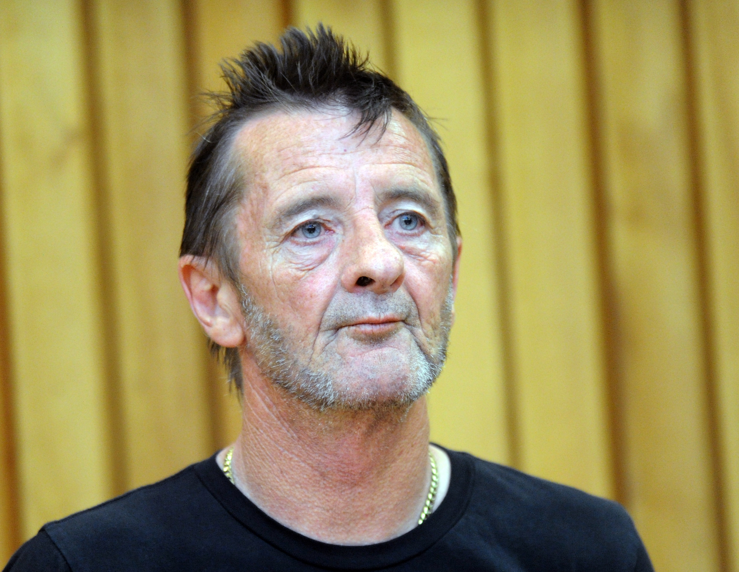 Phil Rudd appears at the High Court for charges of drug posession and threatening to kill, at the District Court in Tauranga, New Zealand, on Nov. 26, 2014