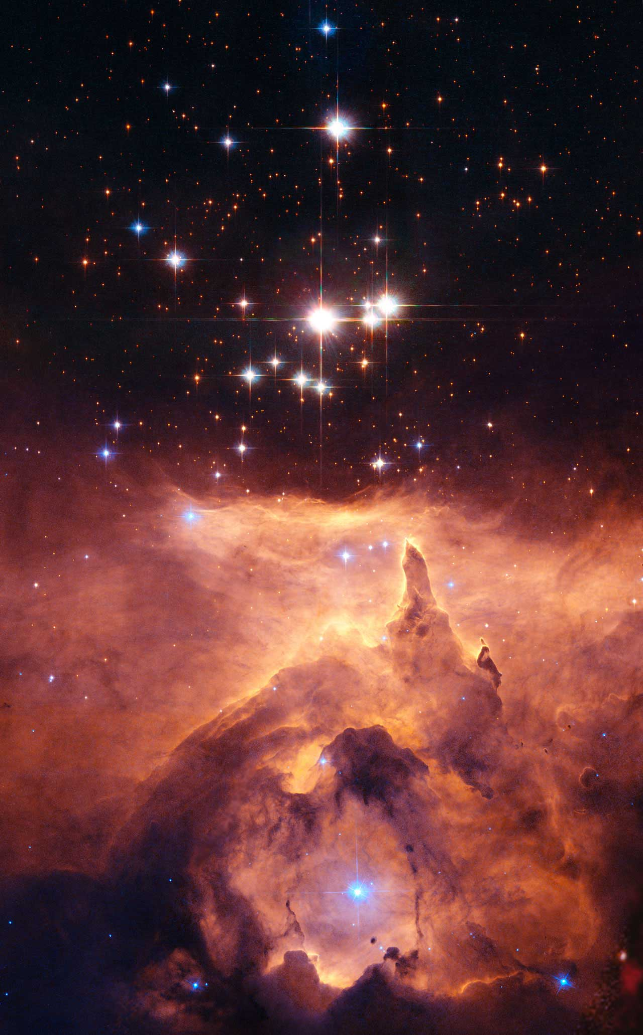 <strong>Pismis 24</strong>:                                   The small open star cluster Pismis 24 lies in the core of the large emission nebula NGC 6357 in Scorpius, about 8,000 light-years away from Earth. The brightest object in the picture is designated Pismis 24-1. It was once thought to weigh as much as 200 to 300 solar masses. This would not only have made it by far the most massive known star in the galaxy, but would have put it considerably above the currently believed upper mass limit of about 150 solar masses for individual stars.                                                                      However, Hubble Space Telescope high-resolution images of the star show that it is really two stars orbiting one another. They are estimated to each be 100 solar masses.                                   <i>Image released on Dec. 11, 2006</i>