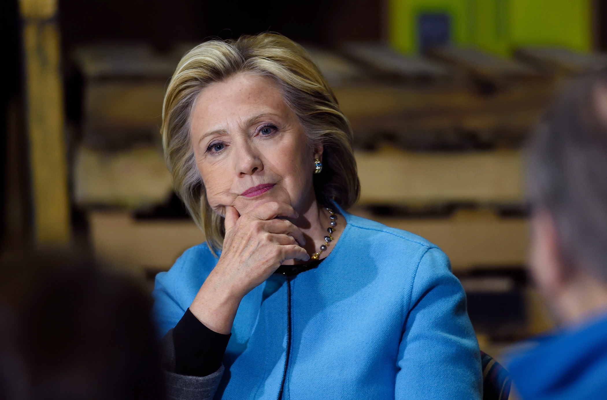 Hillary Clinton participates in a round table discussion with Whitney Brothers management and employees on April 20, 2015 in Keene, NH.