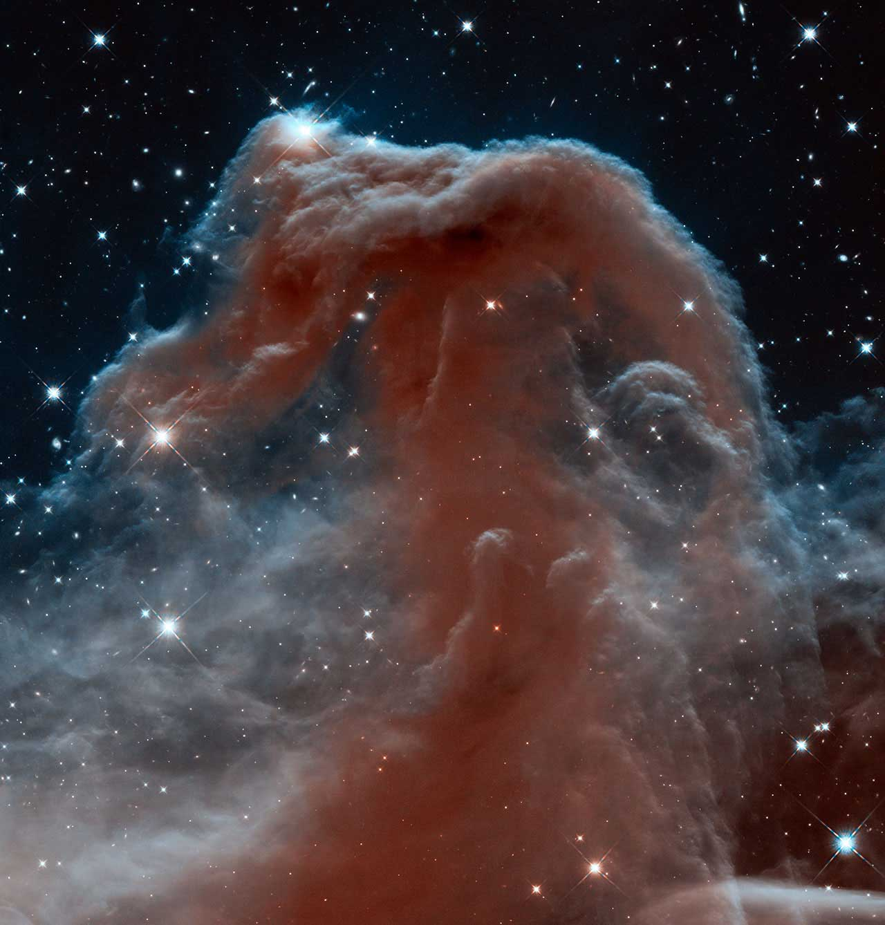 Horsehead Nebula:                                                              Since its launch in April 1990, Hubble has observed and imaged the Horsehead Nebula many times. This new image, released in 2013, shows part of the sky in the constellation of Orion (The Hunter). The nebula, otherwise known as Barnard 33 is shown in infrared light, which has longer wavelengths than visible light and can pierce through the dusty material that usually obscures the nebula's inner regions.                                                               Image released on April 19, 2013