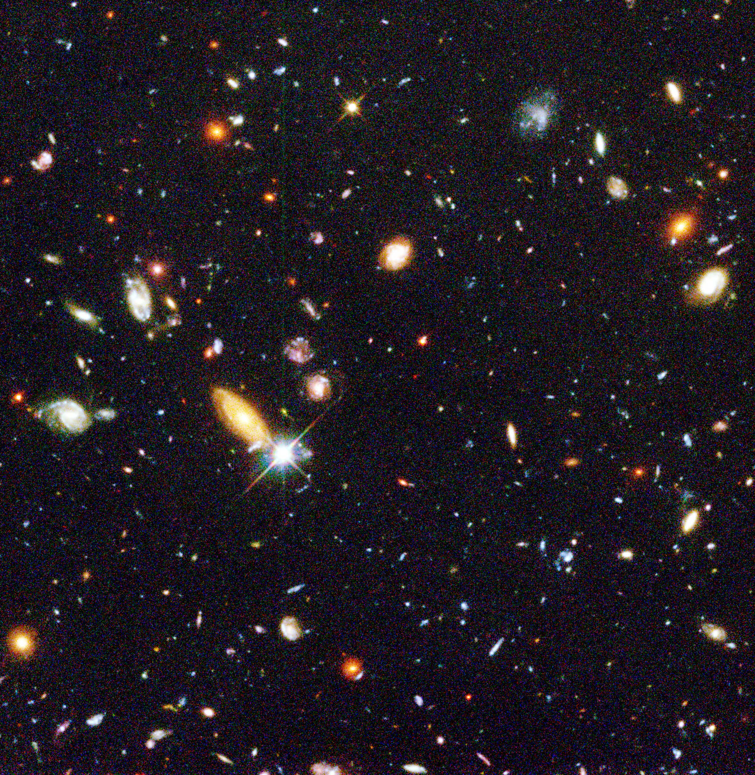 The Hubble Deep Field:                               Mankind's deepest, most detailed optical view of the universe  was assembled from 342 separate exposures taken with the Wide Field and Planetary Camera 2 (WFPC2). Essentially a narrow, deep  core sample  of sky, the HDF is analogous to a geologic core sample of the Earth's crust. Just as a terrestrial core sample is a history of events which took place as Earth's surface evolved, the HDF image contains information about the universe at many different stages in time.Image released on Jan. 15, 1996