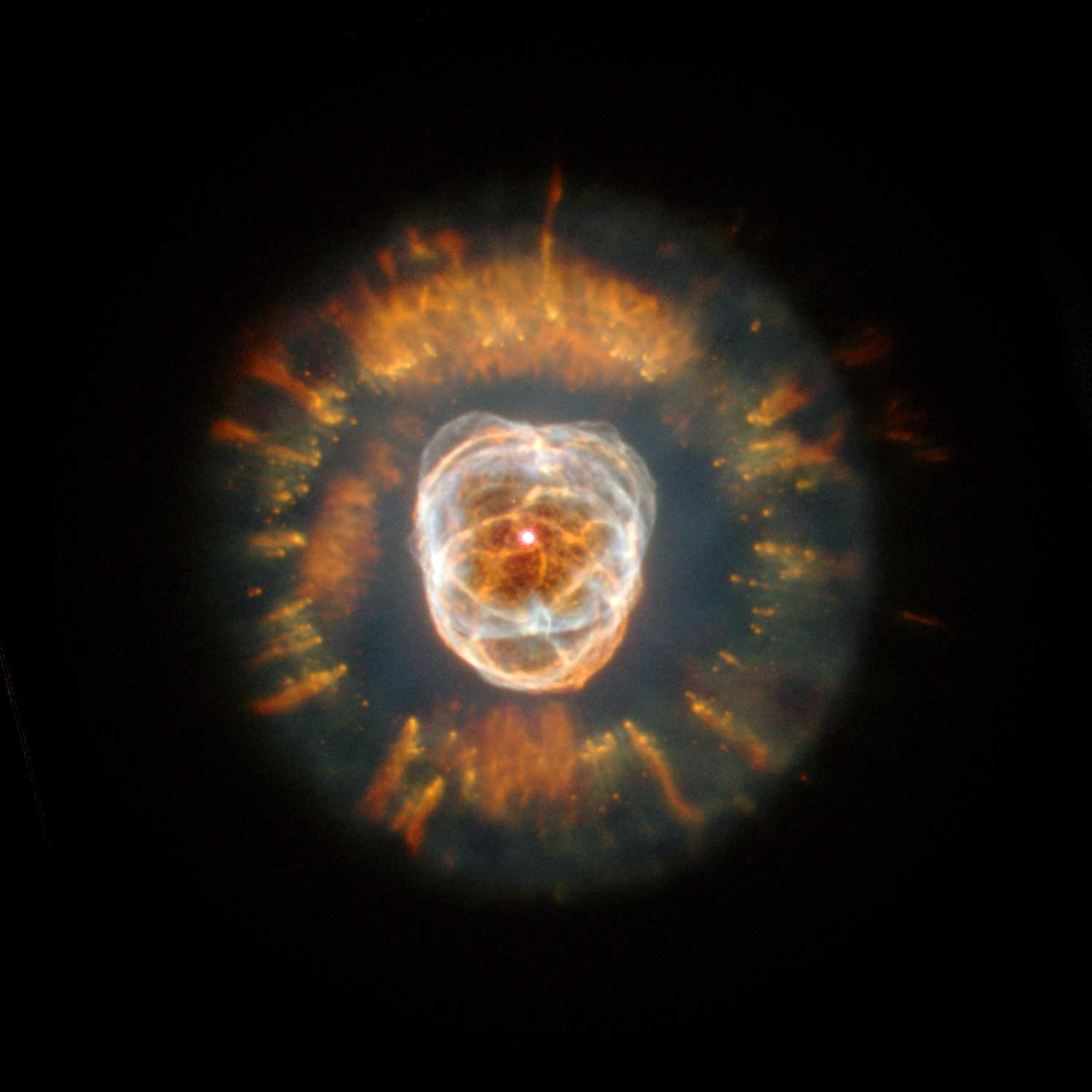 <strong>The Eskimo Nebula</strong>:                                   This planetary nebula, also known as NGC 2392, began forming about 10,000 years ago, when the dying star began flinging material into space. The Eskimo Nebula is about 5,000 light-years from Earth in the constellation Gemini.                                   <i>Image released on Jan. 11, 2000</i>