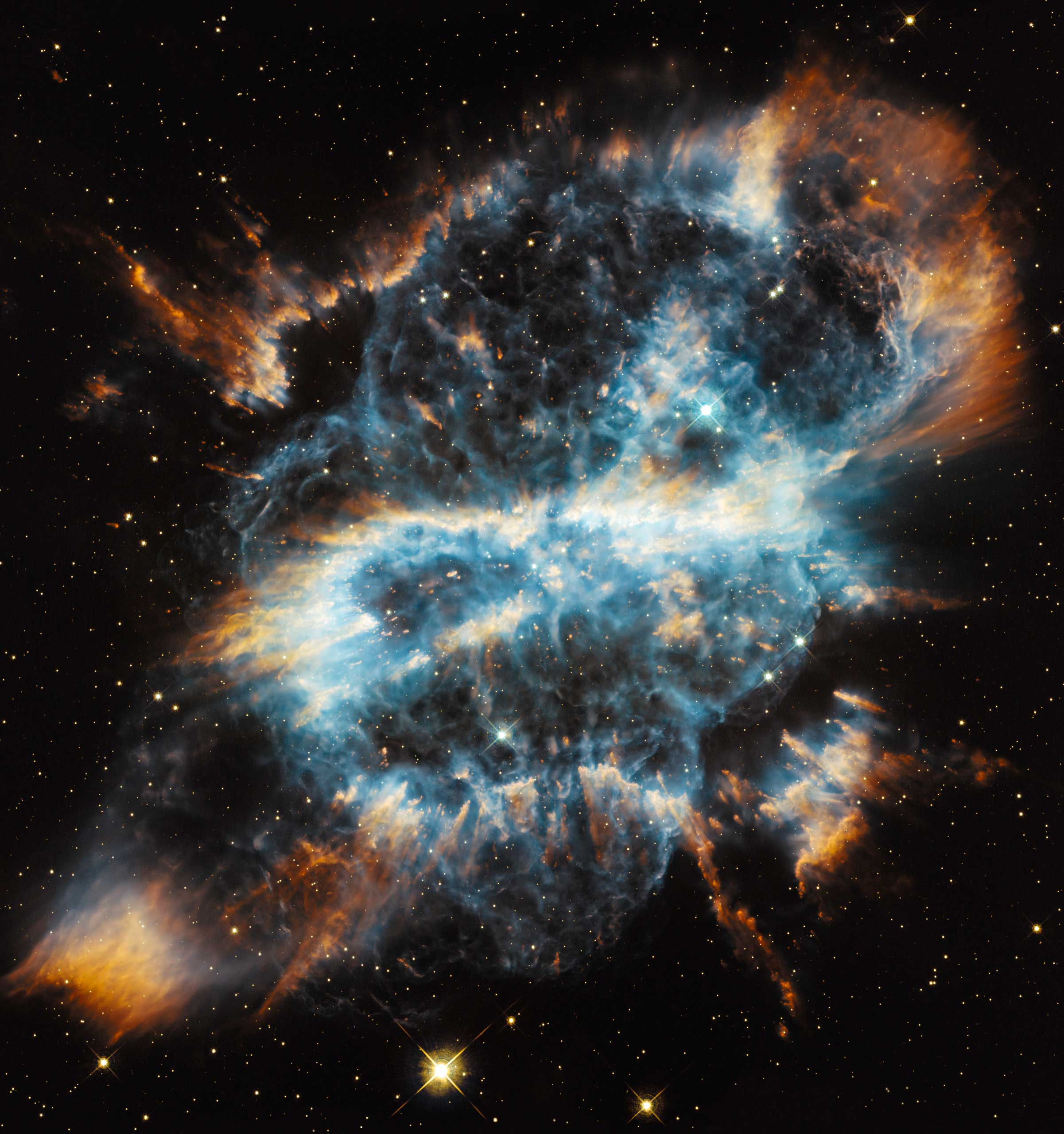 <strong>Planetary Nebula NGC 5189</strong>:                                                                      The nebula is located 1,800 light-years away in the southern constellation Musca. Hubble's image is the most detailed yet made of this object. Its double bipolar or quadrupolar structure could be explained by the presence of a second star orbiting the central star and influencing the pattern of mass ejection.                                                                      <i>Image released on Dec. 18, 2012</i>