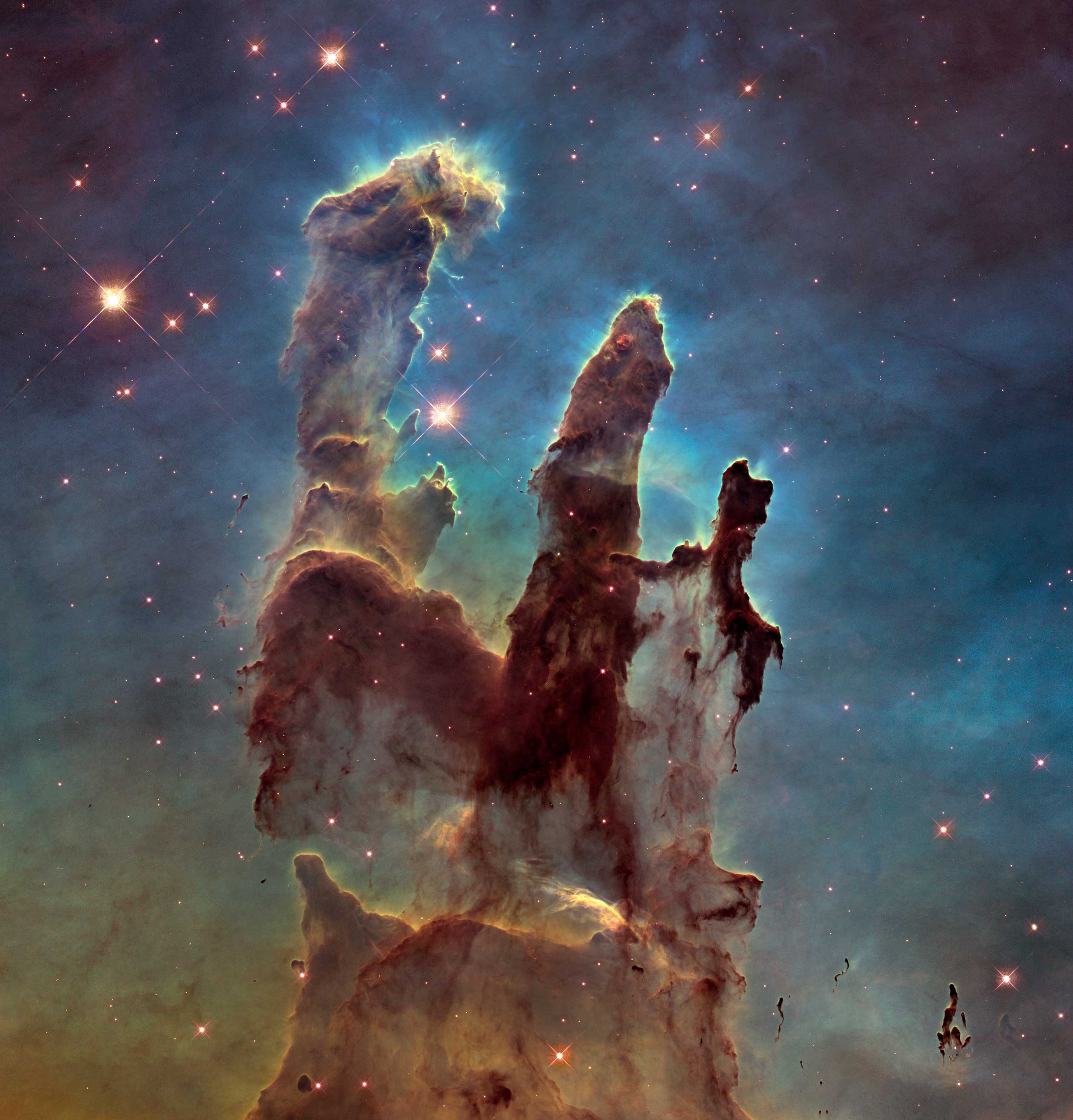 <strong>Pillars of Creation</strong>: Originally taken on April 1, 1995, this image has become one of the most iconic to come from the Hubble Telescope. This version, released in 2015, shows a higher resolution image of the region. The pillars are part of a small region of the Eagle Nebula, a vast star-forming region 6,500 light-years from Earth.                                   <i>Image released in Jan. 2015</i>