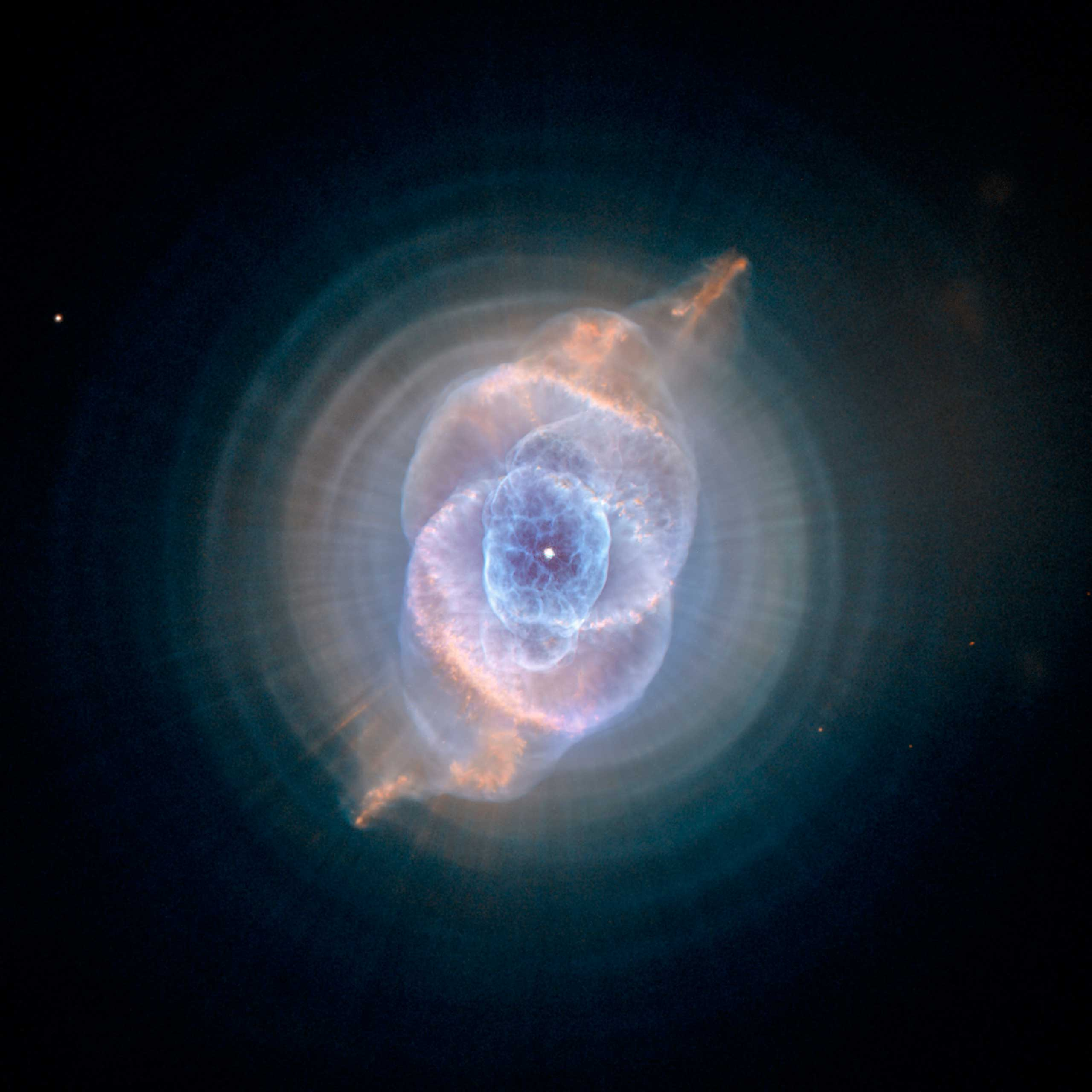 <strong>Cat's Eye Nebula</strong>:                                                                      One of the first planetary nebulae discovered, the Cat's Eye Nebula also has one of the most complex forms known to this kind of nebula. Eleven rings, or shells, of gas make up the Cat's Eye.                                                                      <i>Image released on Sept. 9, 2004</i>
