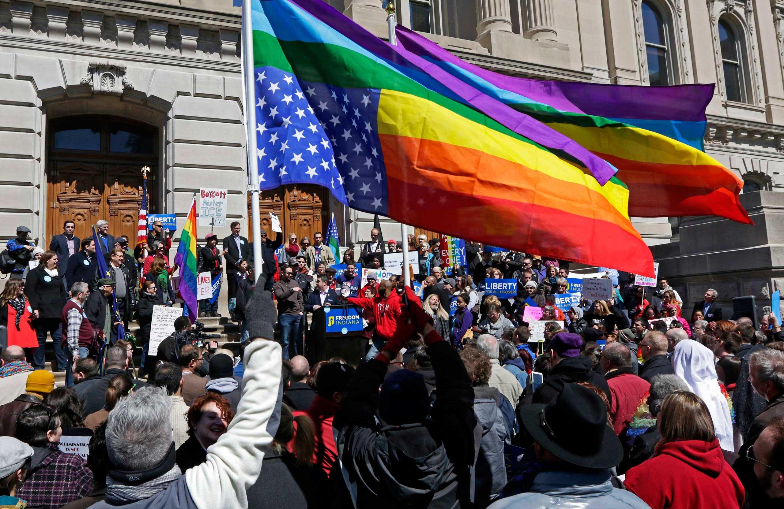 Demonstrators gather to protest a controversial religious freedom bill recently signed by Governor Mike Pence, during a rally at Monument Circle in Indianapolis on March 28, 2015.