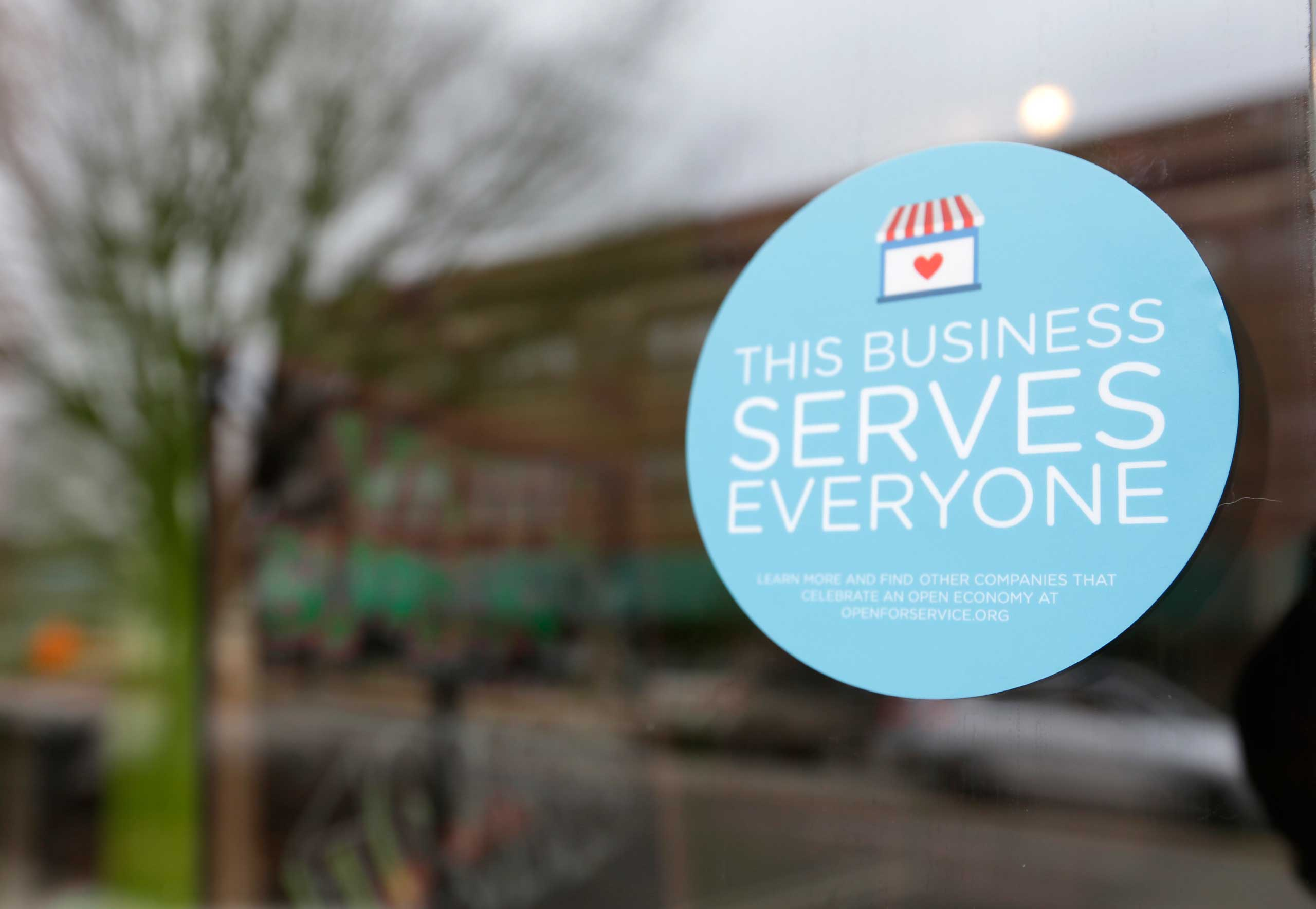 A window sticker on a downtown Indianapolis business, Wednesday, March 25, 2015, shows its objection to the Religious Freedom bill passed by the Indiana legislature.
