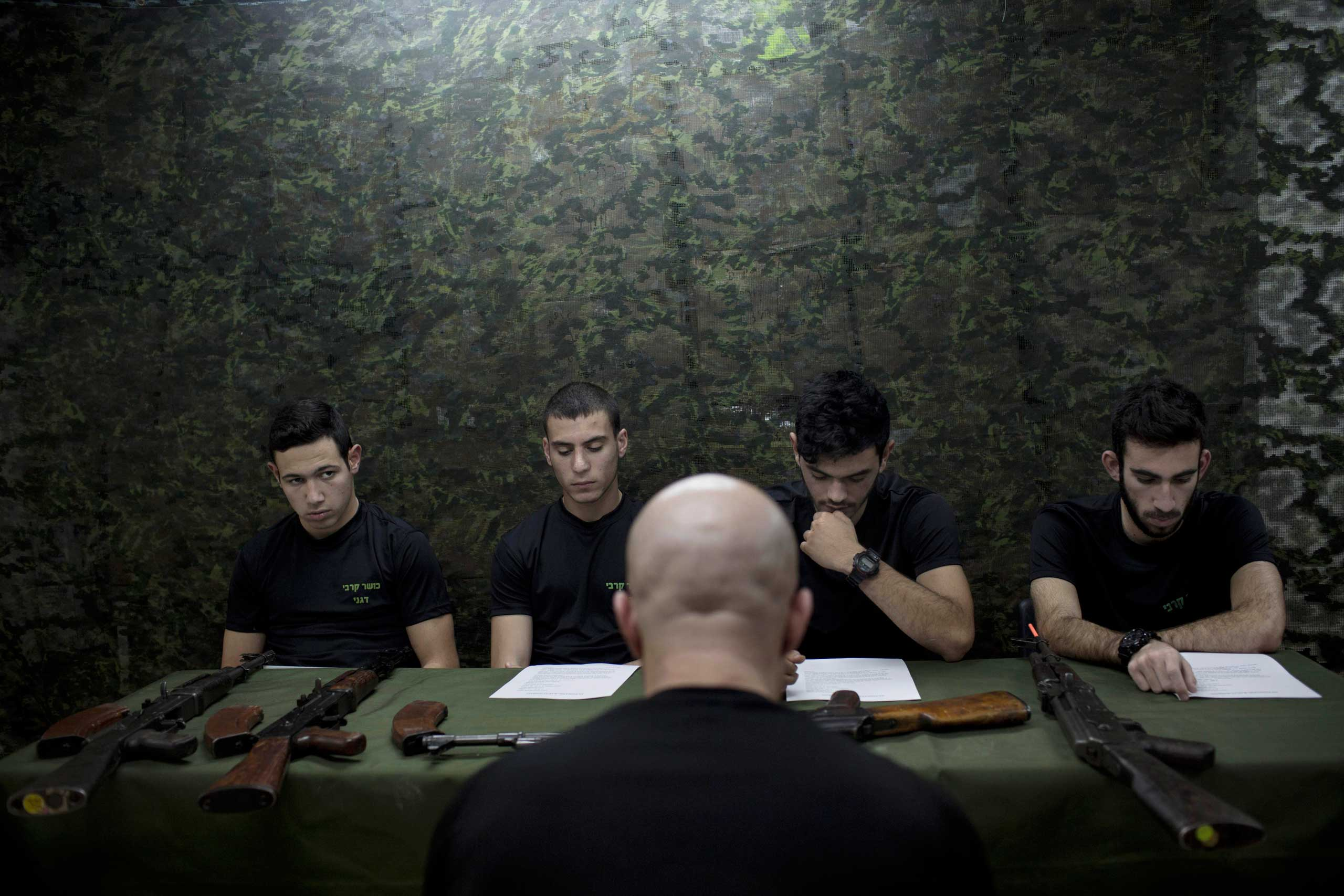 Israeli high-school seniors are instructed on the AK-47 assault rifle as part of a privately run military combat fitness training to prepare for national military service in Netanya, central Israel,  Feb. 17, 2015.