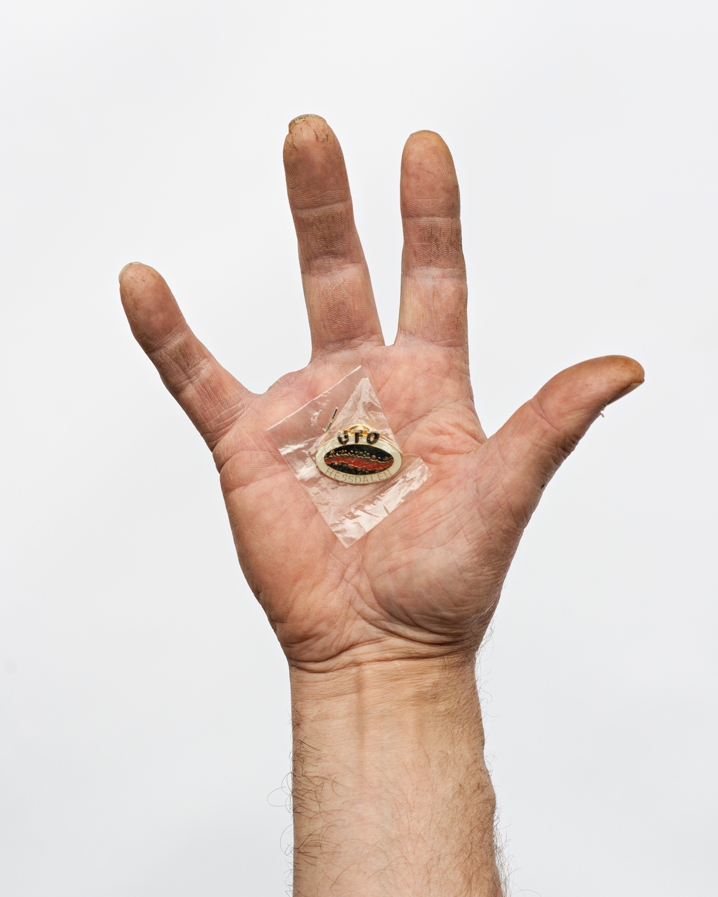 The official Hessdalen UFO pin, in the hand of the salesman. June 2014.