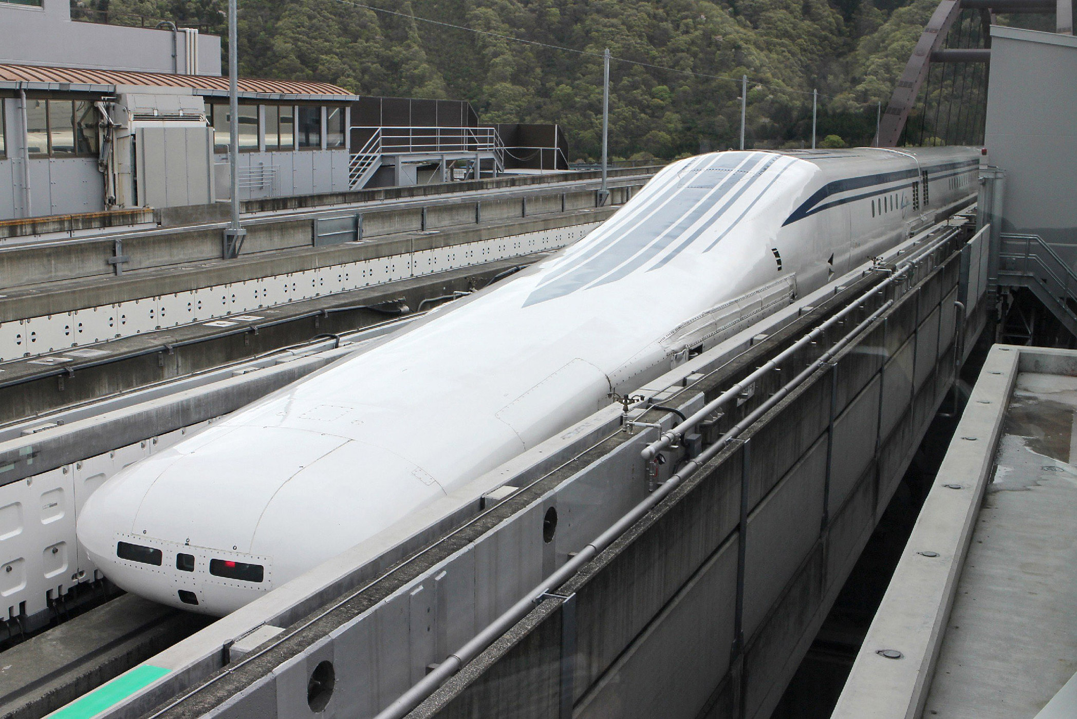 Central Japan Railway's seven-car maglev train returns to the station after setting a new world speed record in a test run near Mount Fuji  on April 21, 2015.