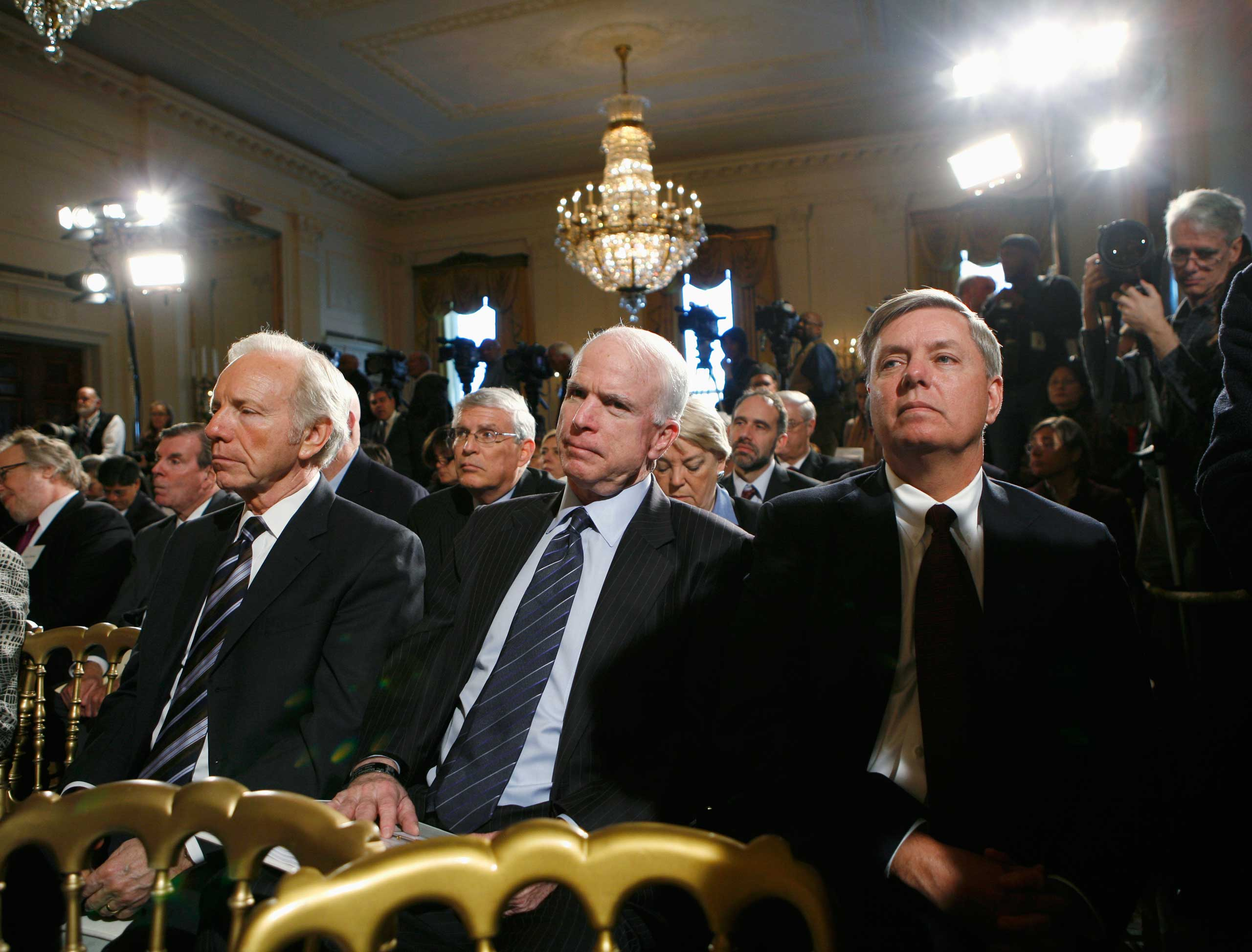 The three amigos, shown here at a White House summit in 2009, have something else in common: They've all run for president.