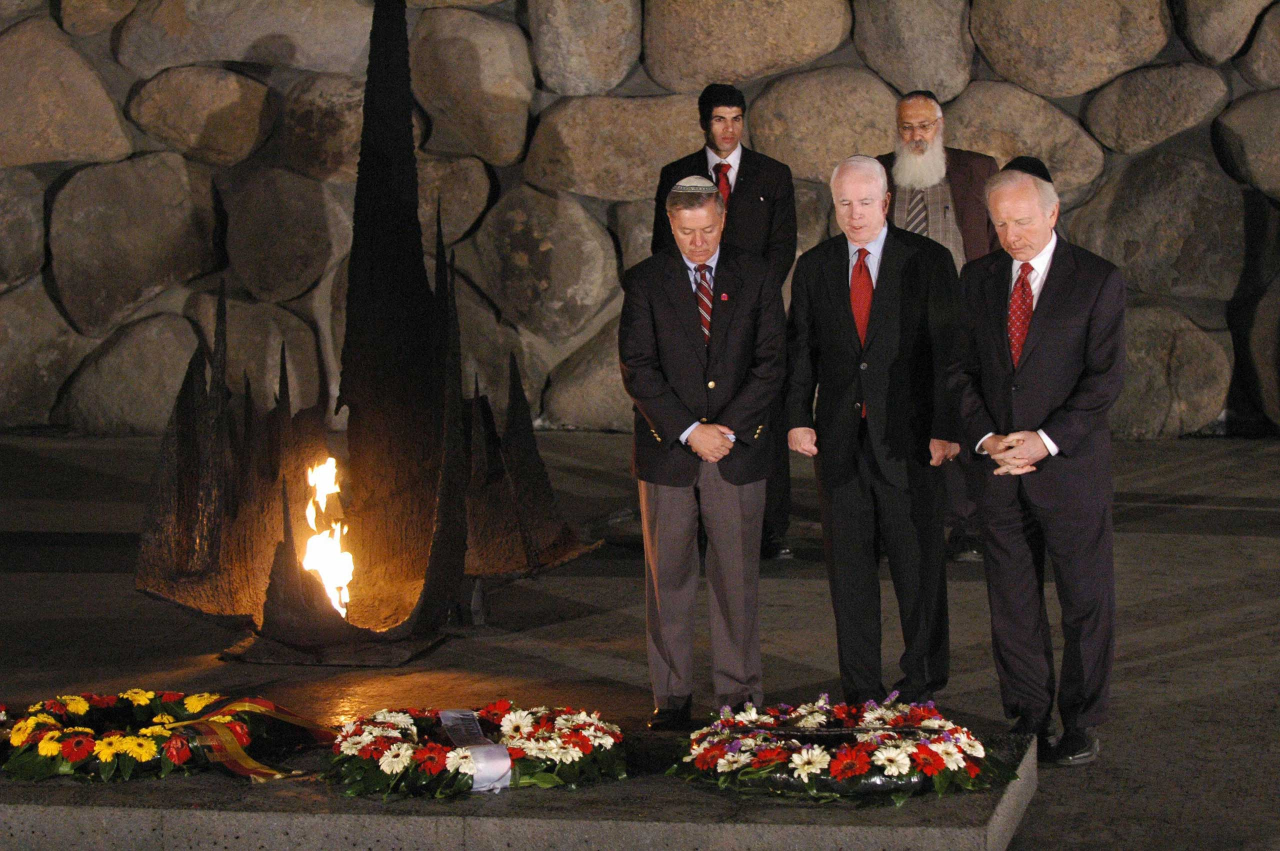 The three Senators, shown here laying a wreath at the Yad Vashem Holocaust museum in Jerusalem, also share strong support for Israel.
