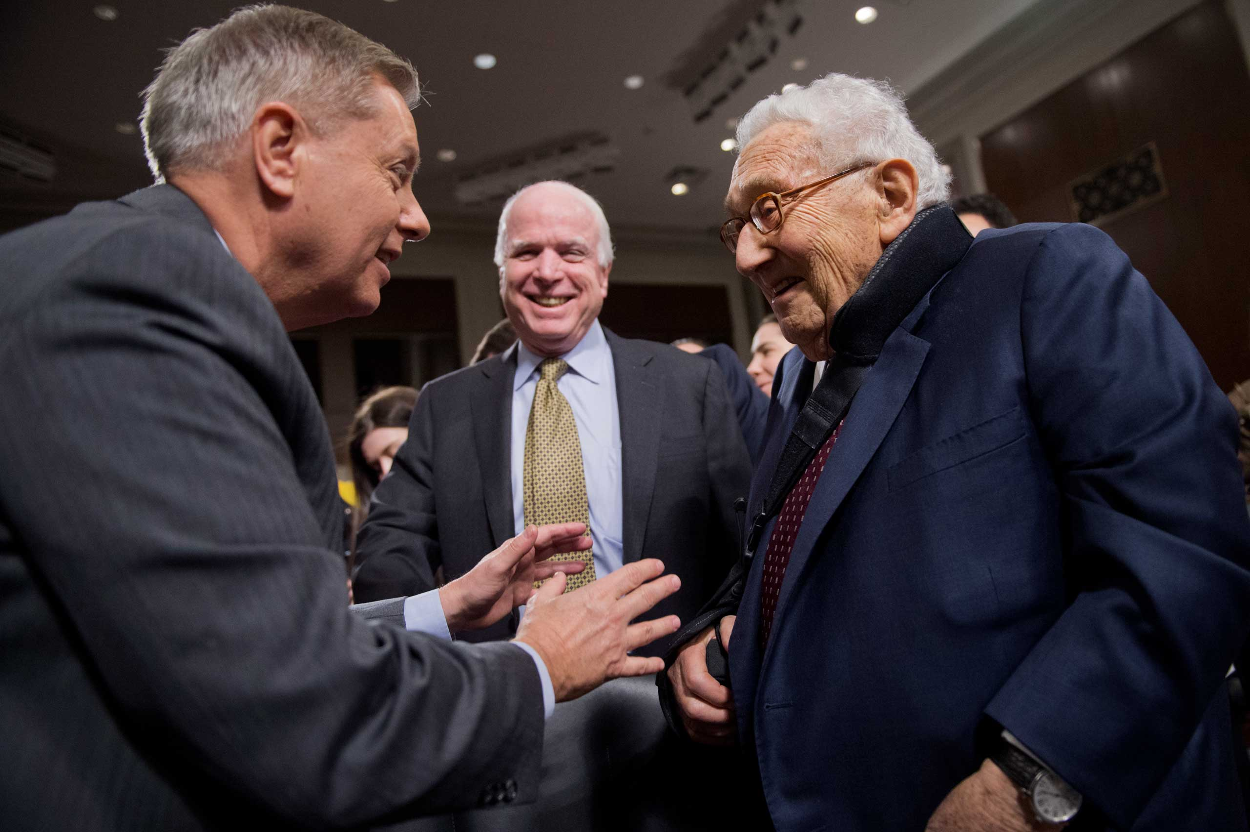 After Lieberman left the Senate in 2013, McCain and Graham, shown here greeting former Secretary of State Henry Kissinger, continued to work together.
