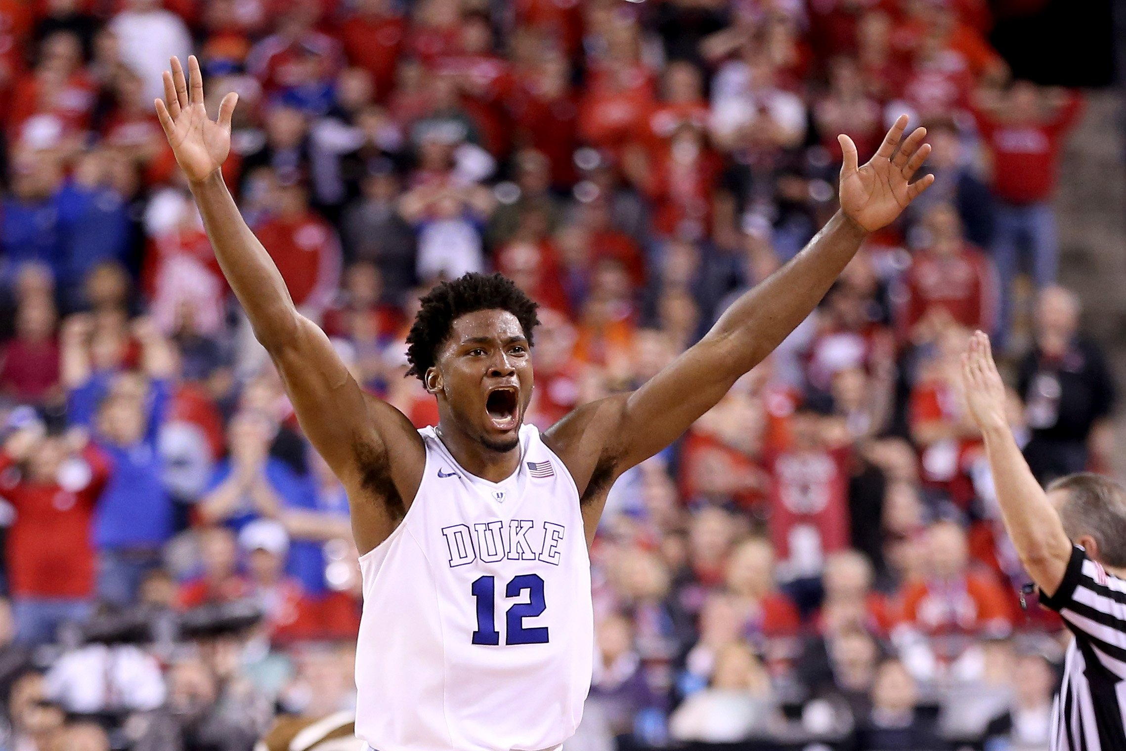 Justise Winslow of the Duke Blue Devils celebrates after defeating the Wisconsin Badgers during the NCAA Men's Final Four National Championship at Lucas Oil Stadium on April 6, 2015 in Indianapolis.