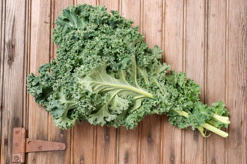 Fresh Kale on Weathered Door