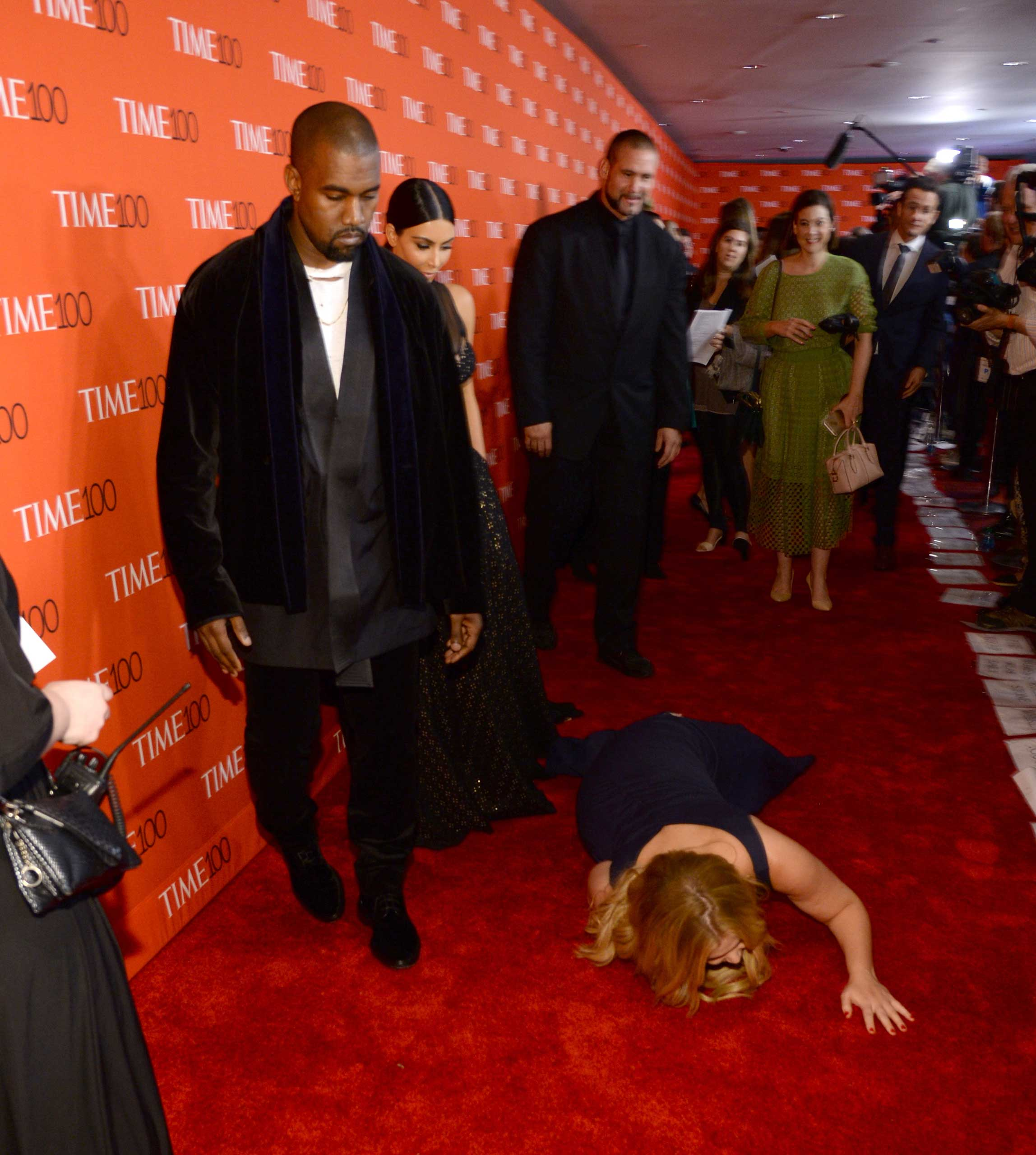 Kanye West and Kim Kardashian West, along with Amy Schumer, attend the TIME 100 Gala at Jazz at Lincoln Center in New York City on Apr. 21, 2015.