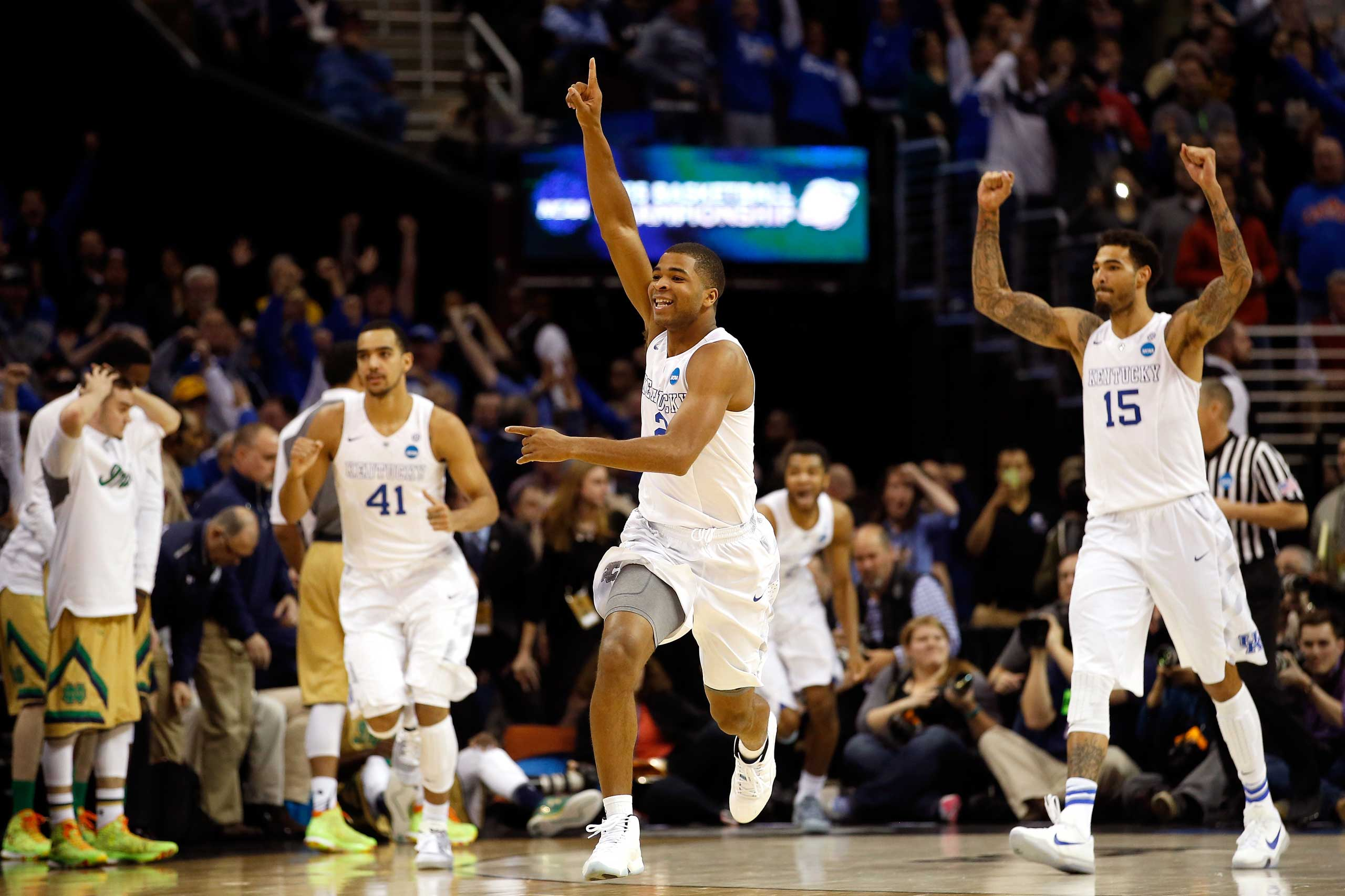 Aaron Harrison of the Kentucky Wildcats celebrates after defeating the Notre Dame Fighting Irish during the Midwest Regional Final of the 2015 NCAA Men's Basketball tournament at Quicken Loans Arena in Cleveland, on Mar. 28, 2015.