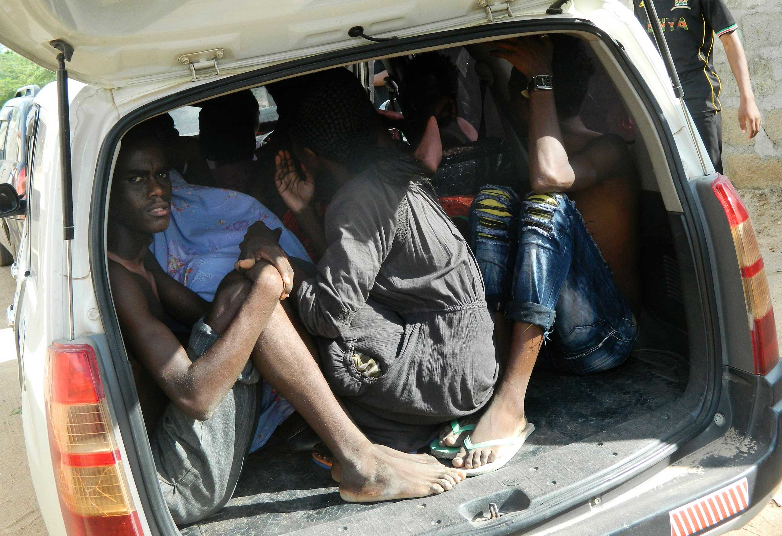 Students of the Garissa University College take shelter in a vehicle after fleeing from an attack by gunmen in Garissa, Kenya, April 2, 2015.