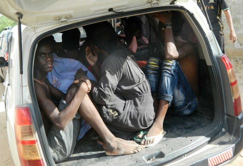 Students of Garissa University College take shelter in a vehicle after fleeing from an attack on the campus, in northeastern Kenya, on April 2, 2015.