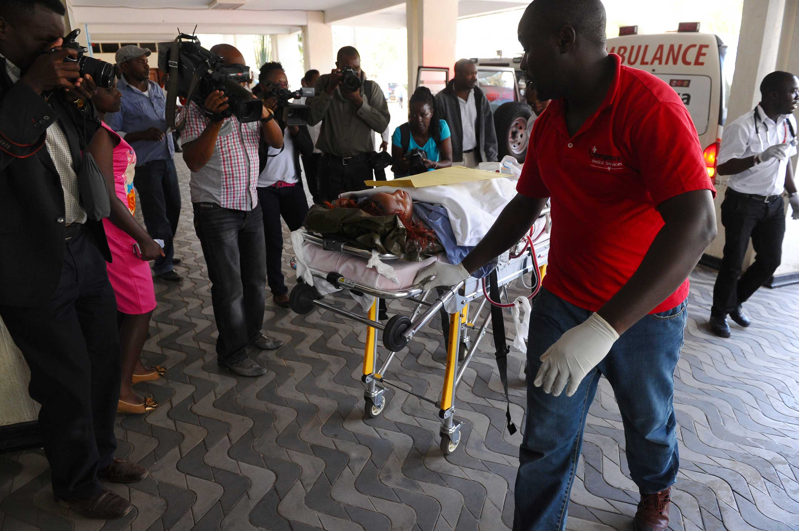 Medics help an injured person at Kenyatta National Hospital in Nairobi after being airlifted from the site of an attack at Garissa University College, in northeastern Kenya, on April 2, 2015.