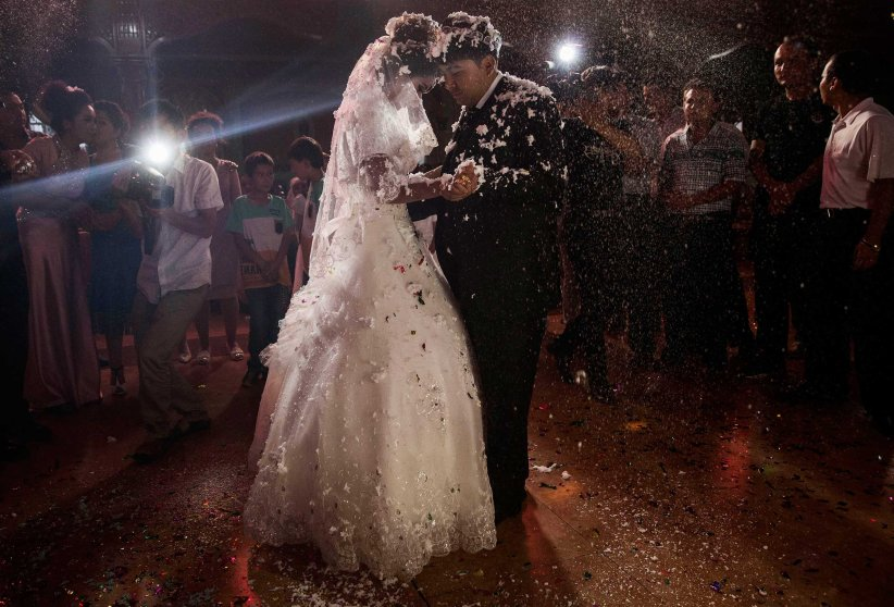 A Uighur couple have their first dance at their wedding celebration after being married in Kashgar, Xinjiang Province, China, on Aug. 2, 2014.