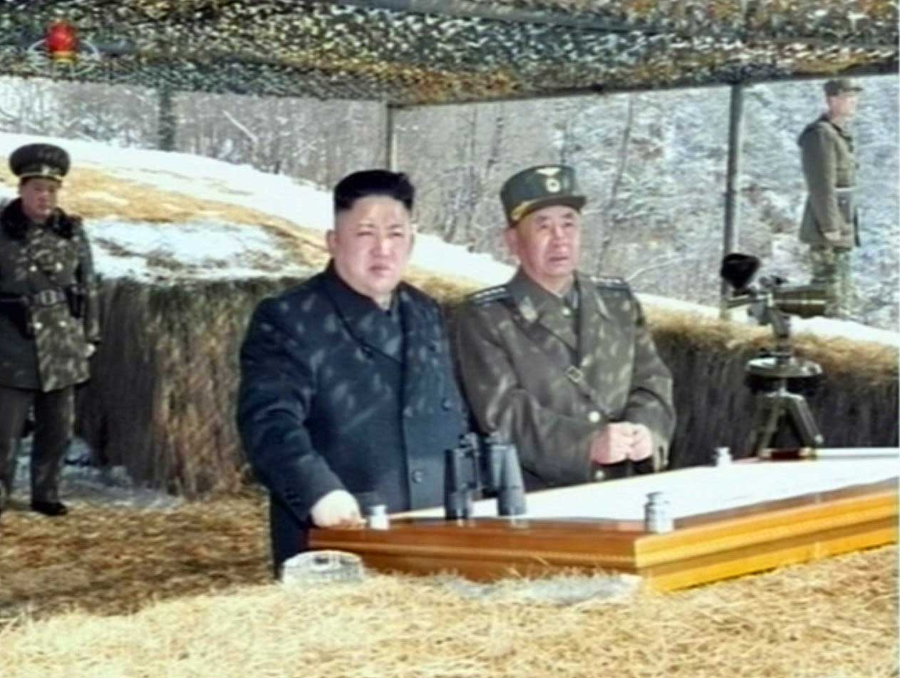 This video grab taken from North Korean TV on March 20, 2013 shows North Korean leader Kim Jong-Un's overseeing a live fire military drill.
