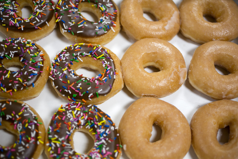A box of Krispy Kreme Doughnuts Inc. doughnuts is arranged for a photograph in Washington, D.C., June 17, 2013.