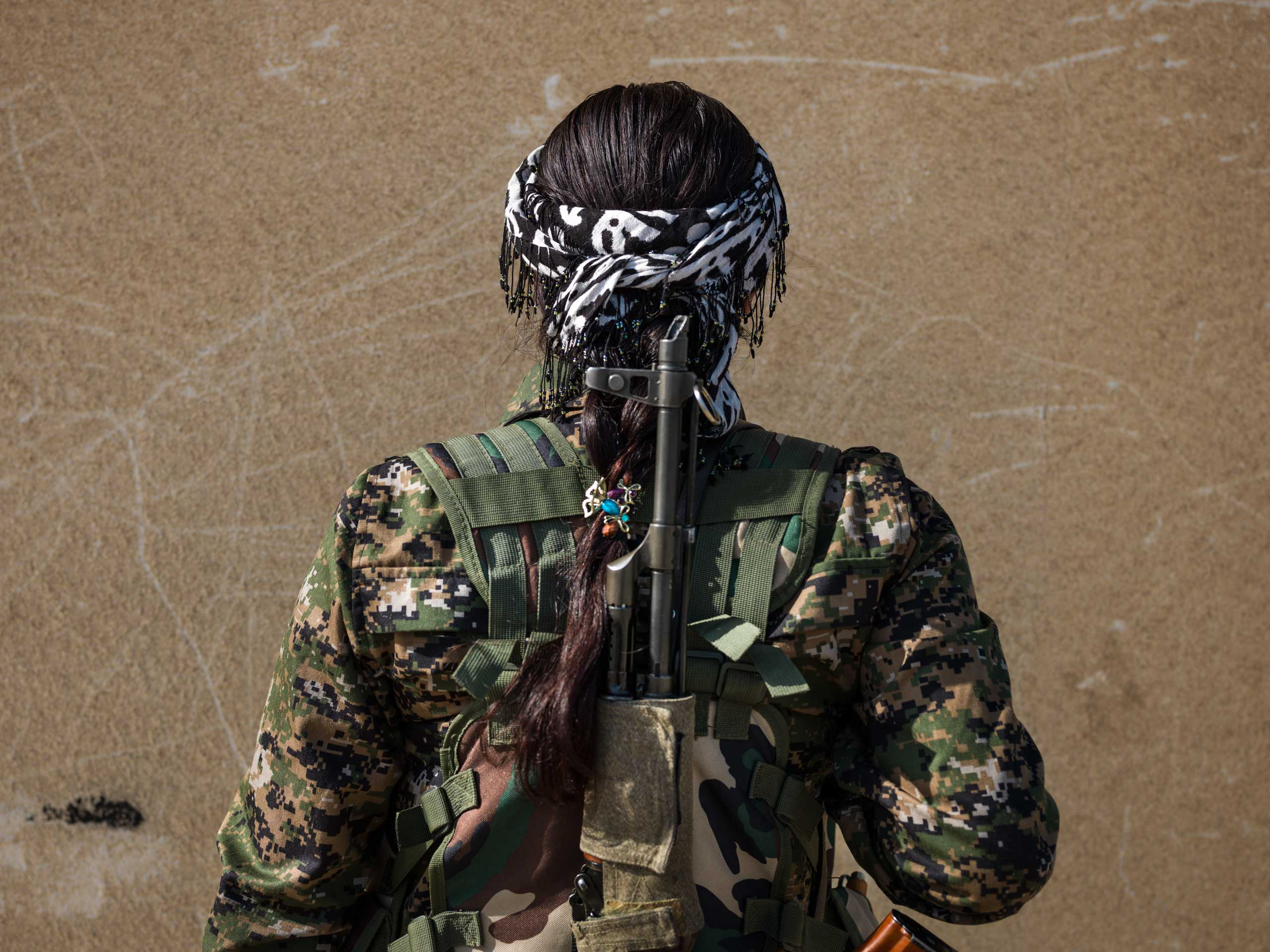 20 year-old YPJ fighter Beritan Khabat from Derek, Syria. She joined the YPJ four years ago to protect her homeland and put an end to the suppression of women.  I fought ISIS in Jezza and Serikani.  Women of YPJ are not scared of ISIS.