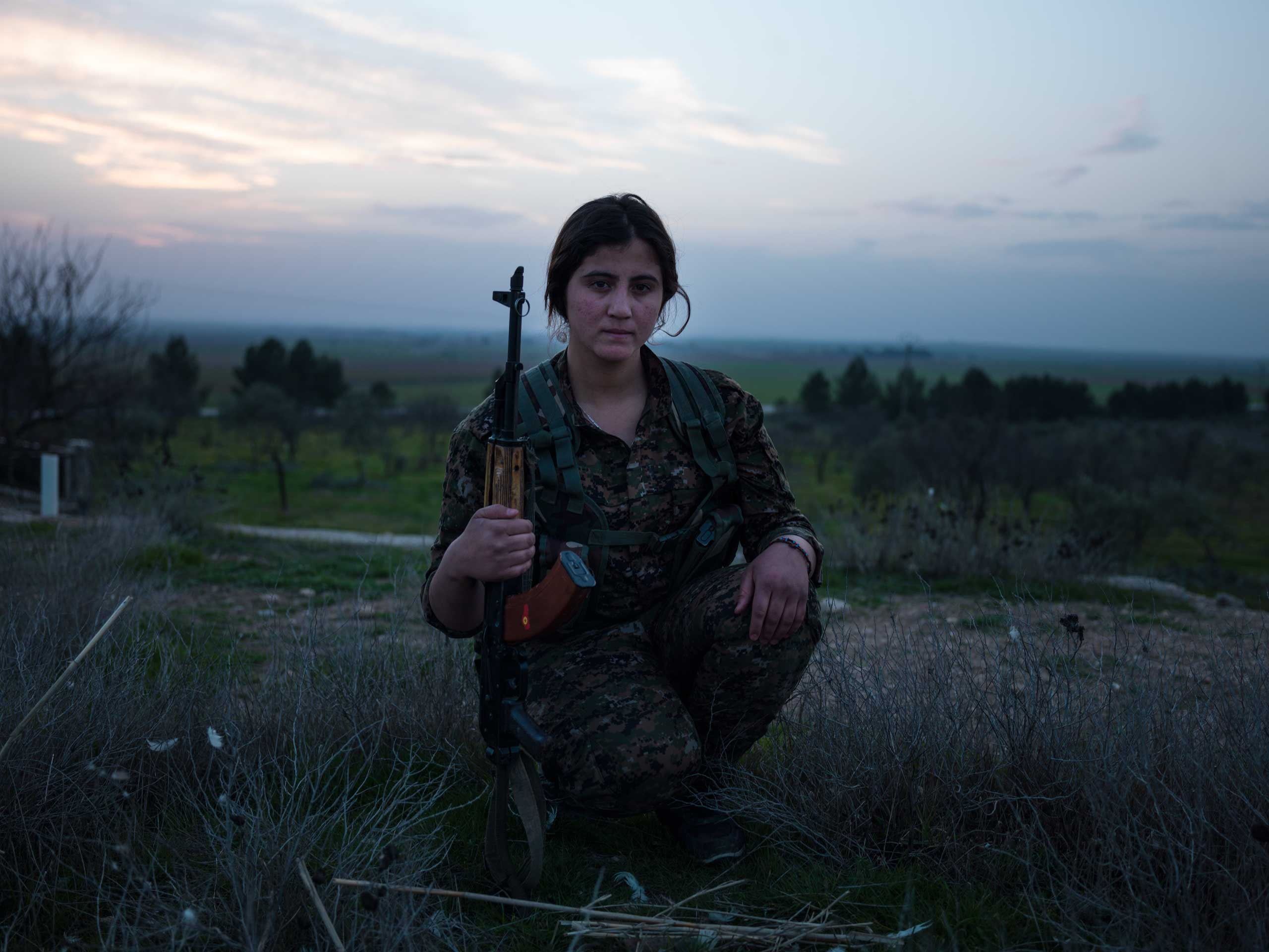 "20-year old YPJ fighter Aijan Denis from Amuda, Syria:                                    ""Where I am now, men and women are equal and we all have the same thought, which is fighting for our ideology and the rights of women. My three sisters and I are all in YPJ."""