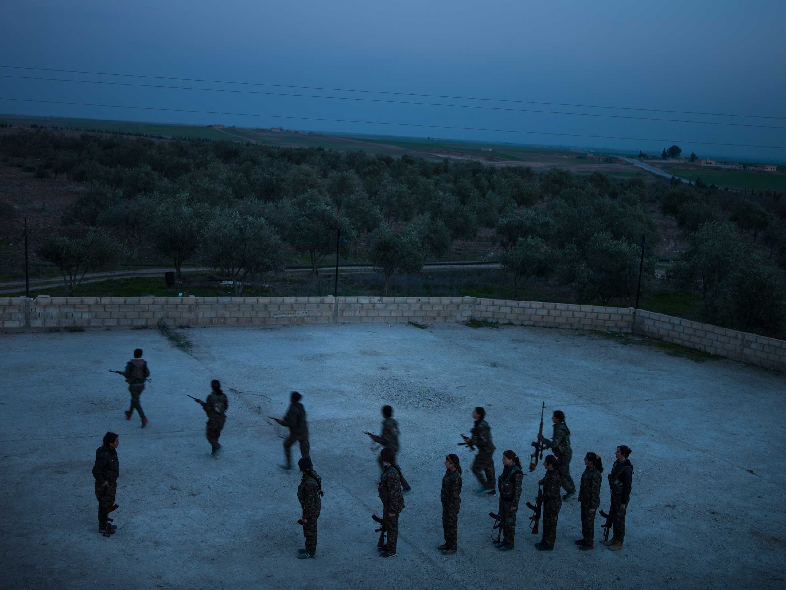 YPJ members take part in daily combat training at their base in Serikani. Syria.