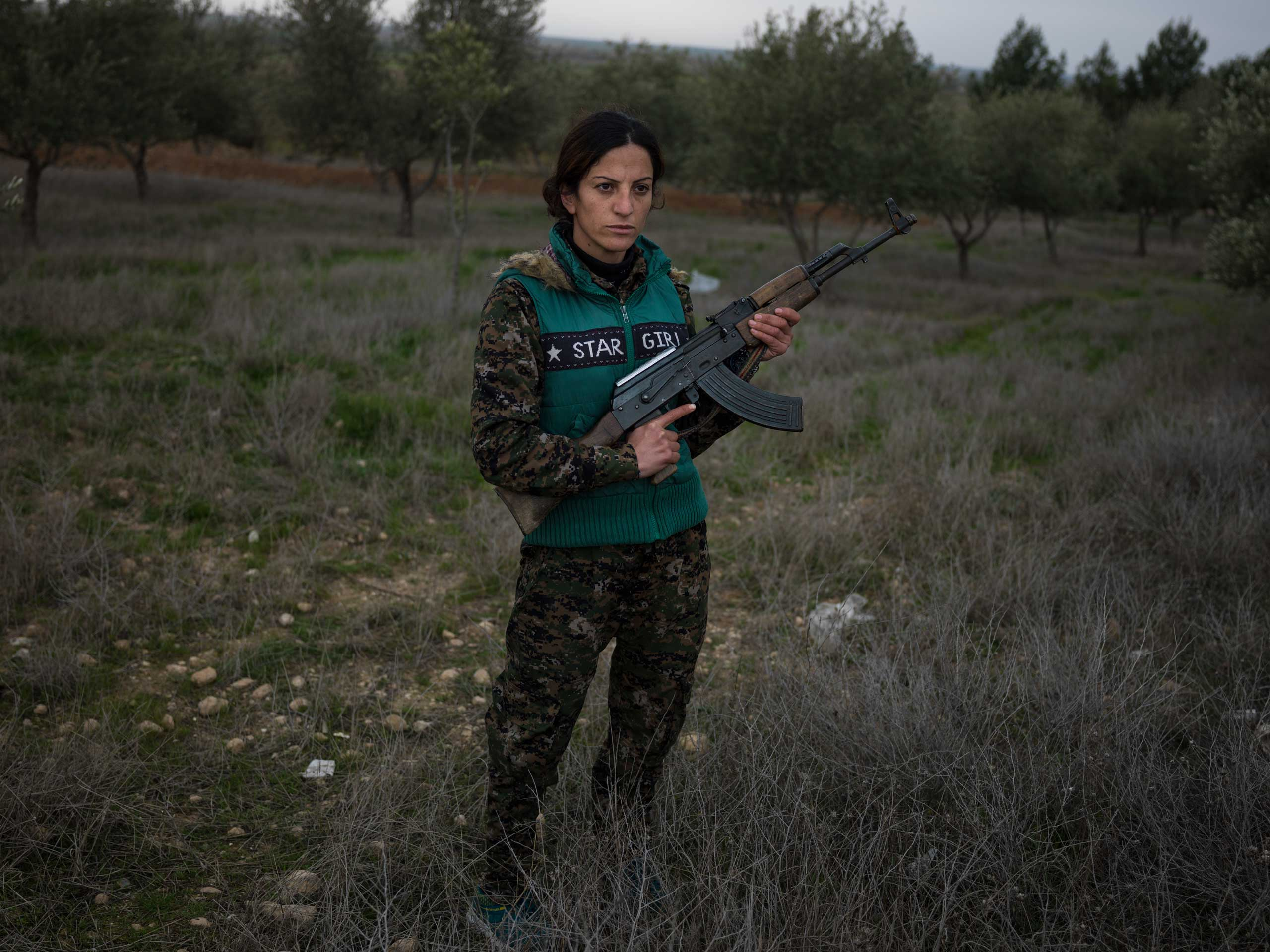 "18 year-old YPJ fighter Saria Zilan from Amuda, Syria:                                   ""I fought ISIS in Serikani. I captured one of them and wanted to kill him, but my comrades did not let me. He kept staring at the ground and would not look at me, because he said it was forbidden by his religion to look at a woman."""