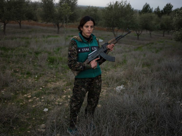 """18 year-old YPJ fighter Saria Zilan from Amuda, Syria:""""I fought with ISIS in Serikani. I captured one of them and wanted to kill him, but my comrades did not let me. He kept staring at the ground and would not look at me, because he said it was forbidden by his religion to look at a woman."""" Newsha Tavakolian for TIME """"It's been one year and four months since I joined YPJ. When I saw Martyr Deli on TV after ISIS beheaded her, I went to her burial ceremony the next day in Amuda. I saw Deli's mother sobbing madly. Right there I swore to myself to avenge her death. I joined YPJ the day after. In the past, women had various roles in the society. but all those roles were taken from them. We are here now to take back the role of women in society. I grew up in a country, where I was not allowed to speak my mother tongue of Kurdish. I was not allowed to have a Kurdish name. If you were a pro-Kurdish activist, they'd arrest you and put you in jail. But since the Rojava revolution, we have been getting back our rights. We were not allowed to speak our language before, and now ISIS wants to wipe us off completely from the Earth. I fought with ISIS in Serikani. I captured one of them and wanted to kill him, but my comrades did not let me do so. He kept staring at the ground and would not look at me, because he said it was forbidden by his religion to look at a woman. I have changed a lot. My way of thinking about the world has changed since I joined YPJ. Maybe some people wonder why we're doing this. But when they get to know us better, they will understand why. We are emotional people."""""""