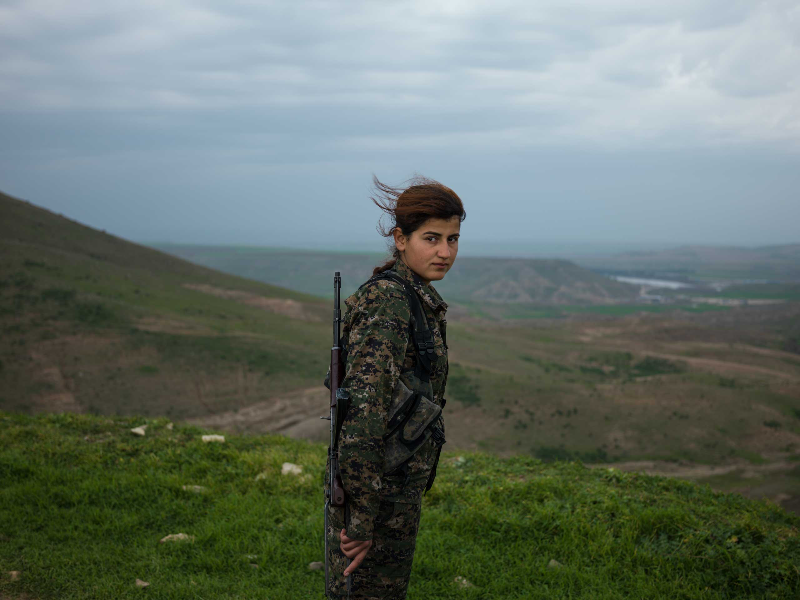 "18-year-old YPJ (Women's Protection Unit) fighter Torin Khairegi: ""We live in                     a world where women are dominated by men.                     We are here to take control of our future. I injured an ISIS jihadi in Kobani. When he was wounded, all his friends left him behind and ran away. Later I went there and buried his body. I now feel that I am very powerful and can defend my home, my friends, my country, and myself. Many of us have been martyred and I see no path other than the continuation of their path."