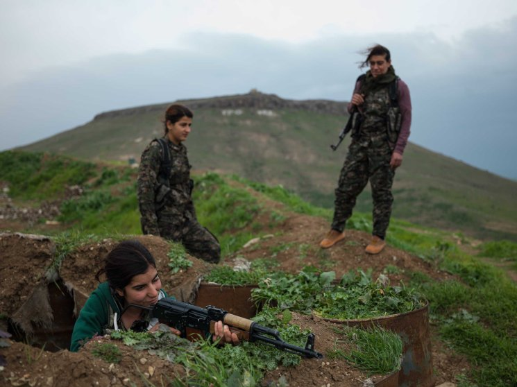 YPJ fighters on their base at the border between Syria and Iraq. Young female fighters are indoctrinated to the ideology of their charismatic leader, Abdullah Ocalan, head of the Kurdish Workers' Party (PKK), who promotes marxist thought and empowerment of women.Newsha Tavakolian for TIME
