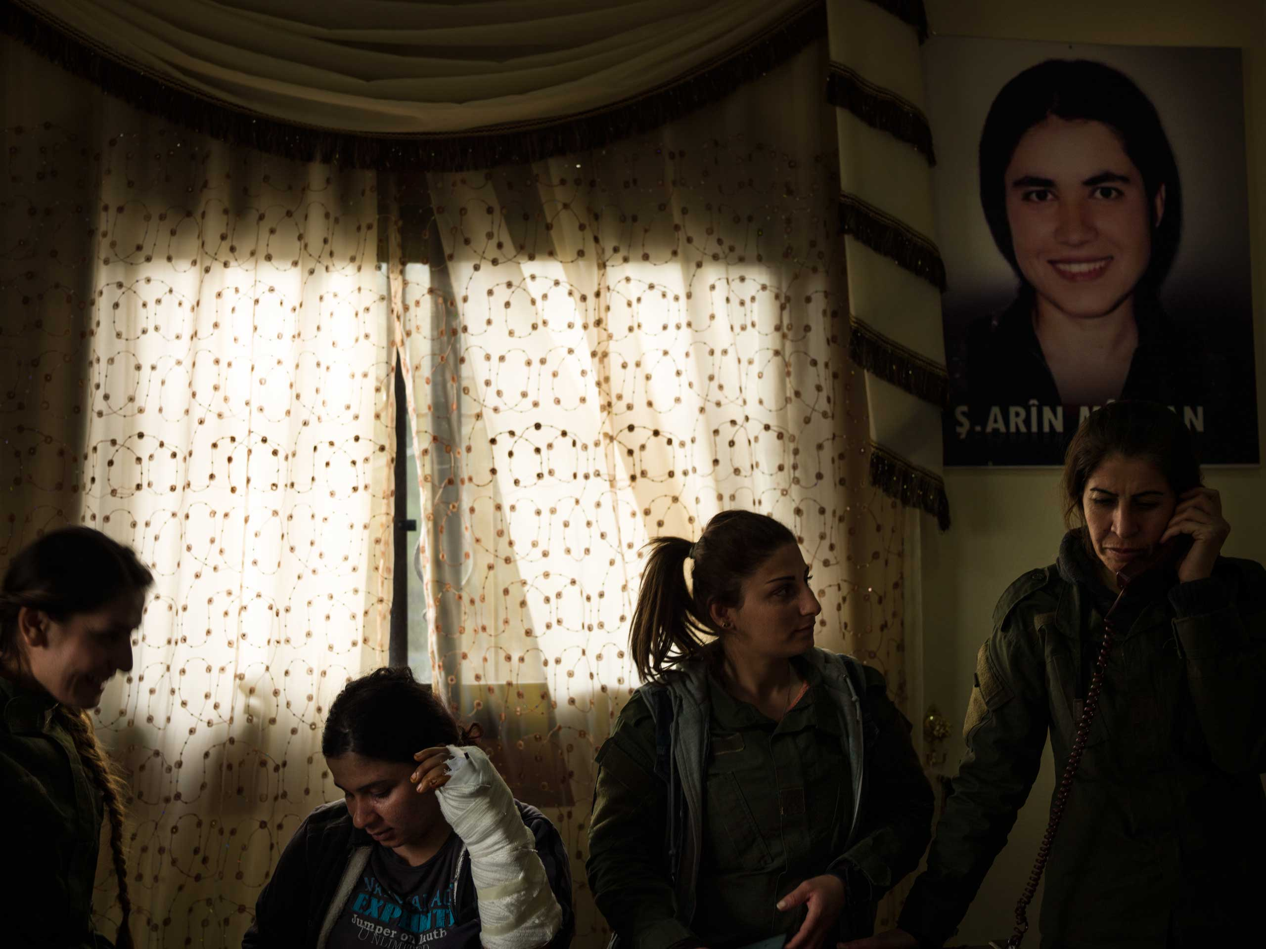 YPJ members, including one who was wounded fighting against ISIS in Kobani, Syria, at the all-women Asayesh Security Base in Derek, Syria.