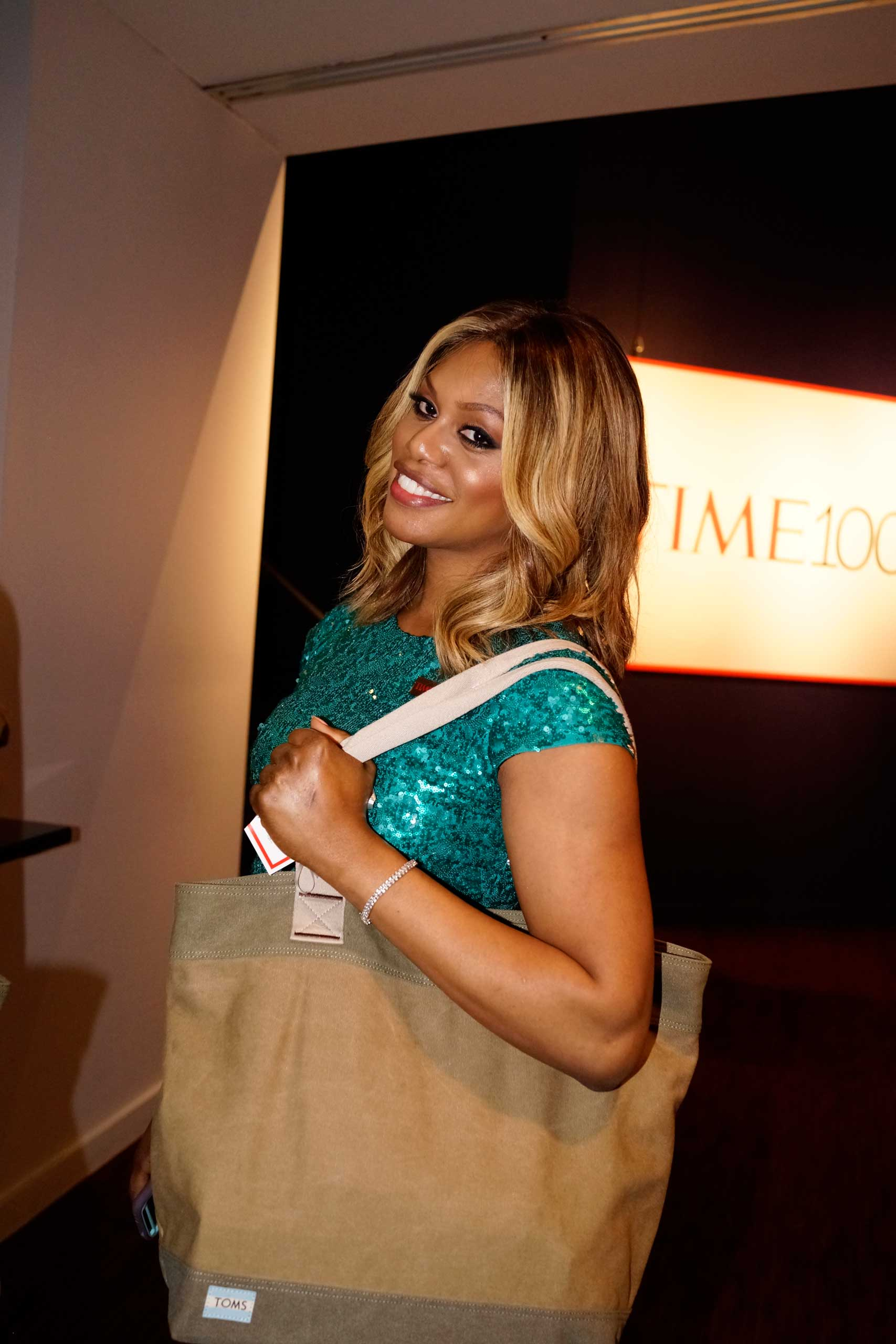 Laverne Cox poses with a TIME 100 gift bag as she attends the TIME 100 Gala at Jazz at Lincoln Center in New York, NY, on Apr. 21, 2015.