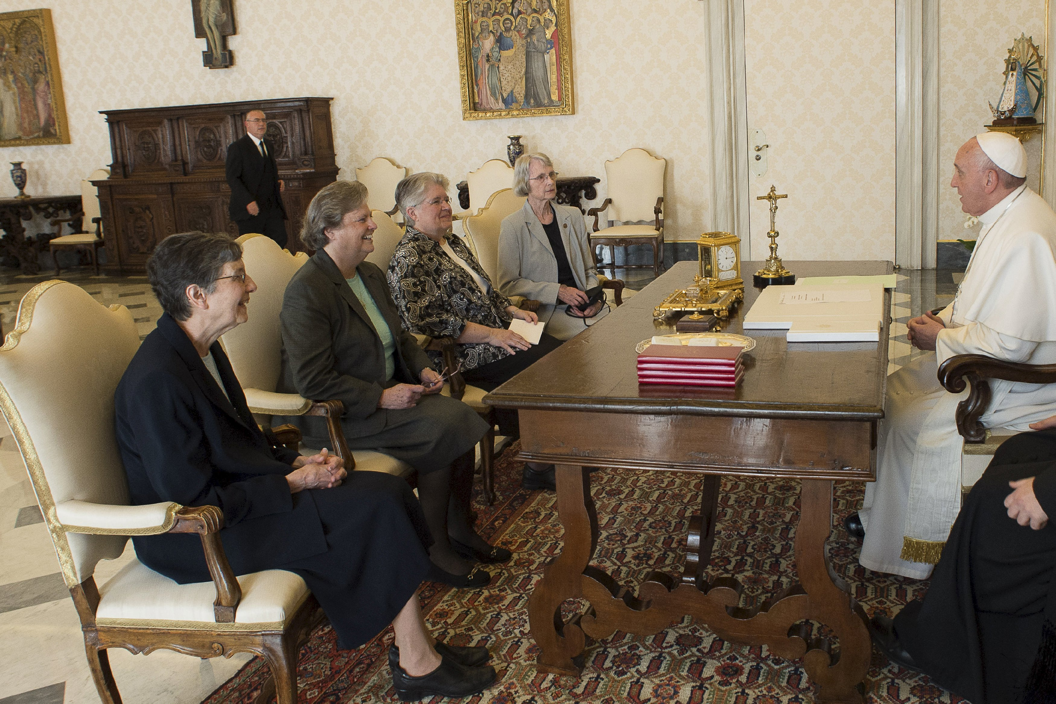 Pope Francis meets members of Leadership Conference of Women Religious (LCWR) during a private audience in the pontiff's studio at the Vatican on April 16, 2015.